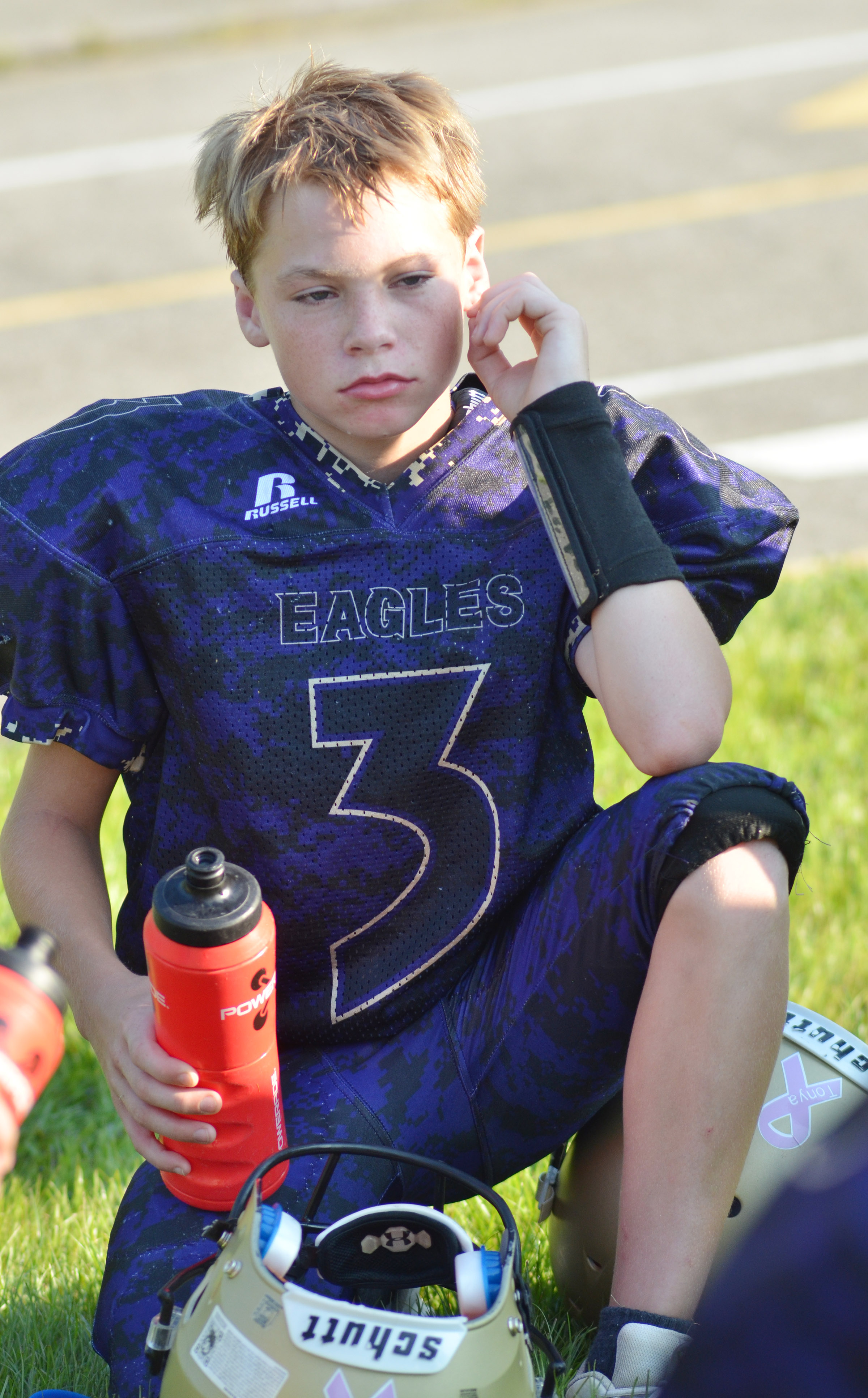 CMS eighth-grader Tuff Harper listens to his coaches.