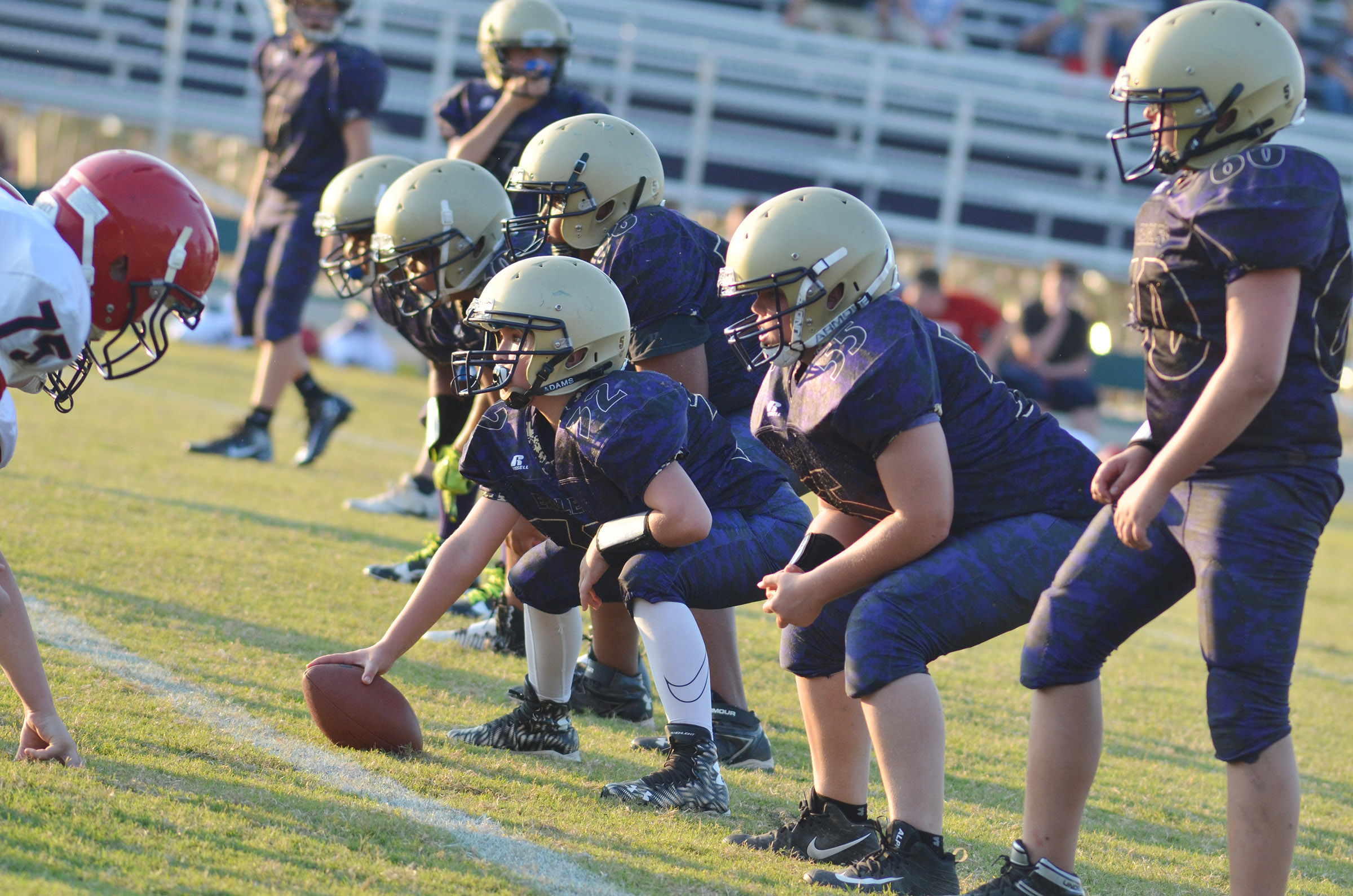 CMS offensive line players get ready for the snap.
