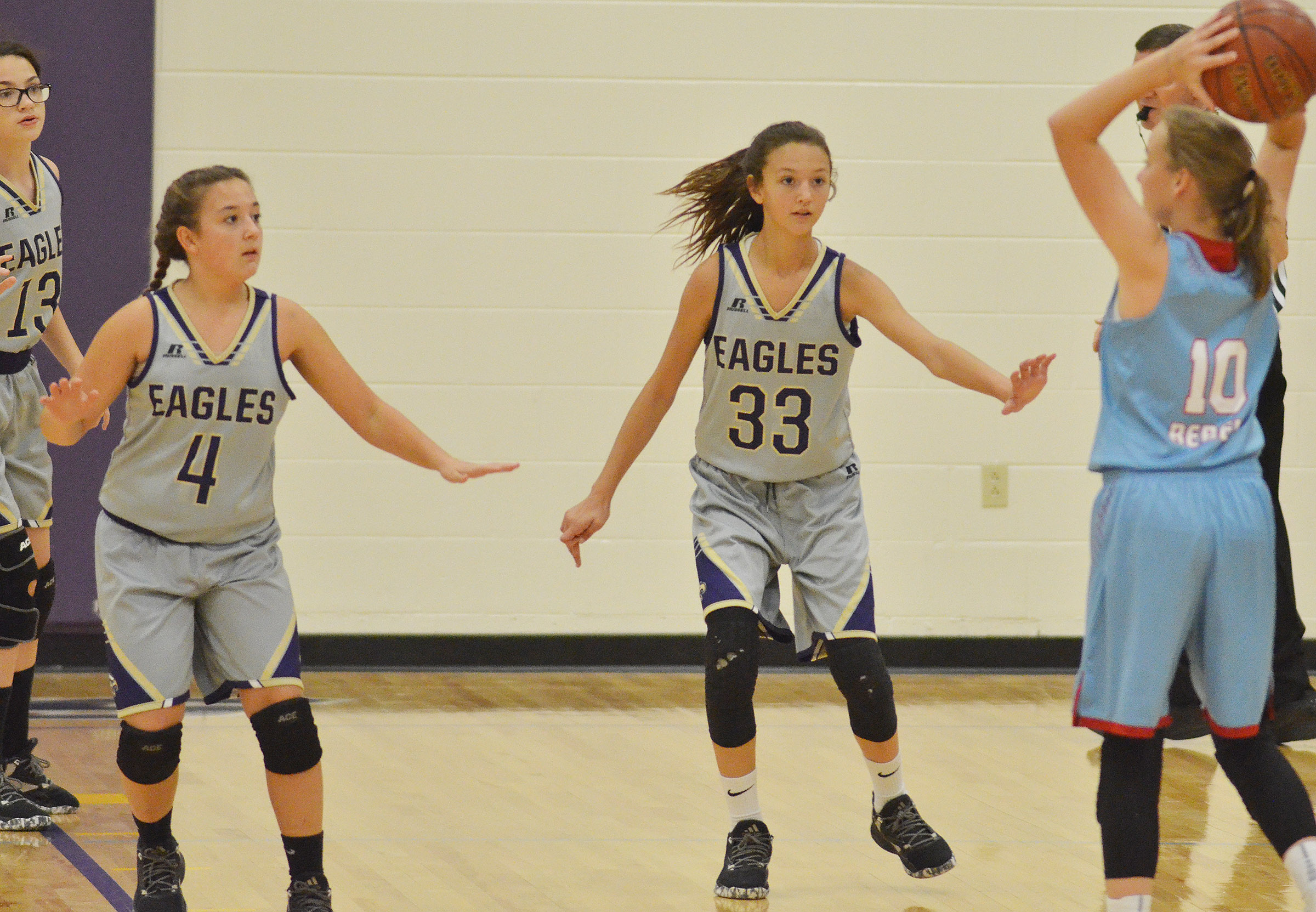 CMS seventh-graders, from left, Mary Russell, Briana Davis and Bri Hayes play defense.