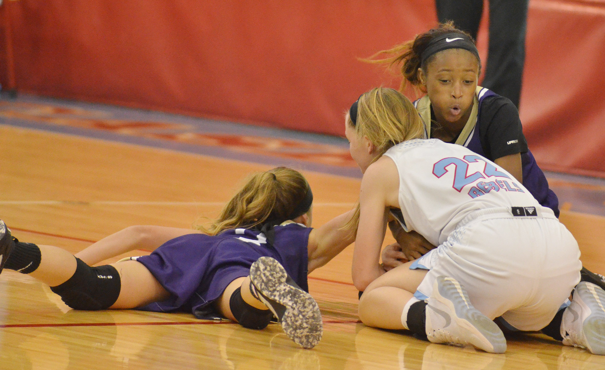CMS eighth-graders Rylee Petett, at left, and Bri Gowdy fight for the ball.