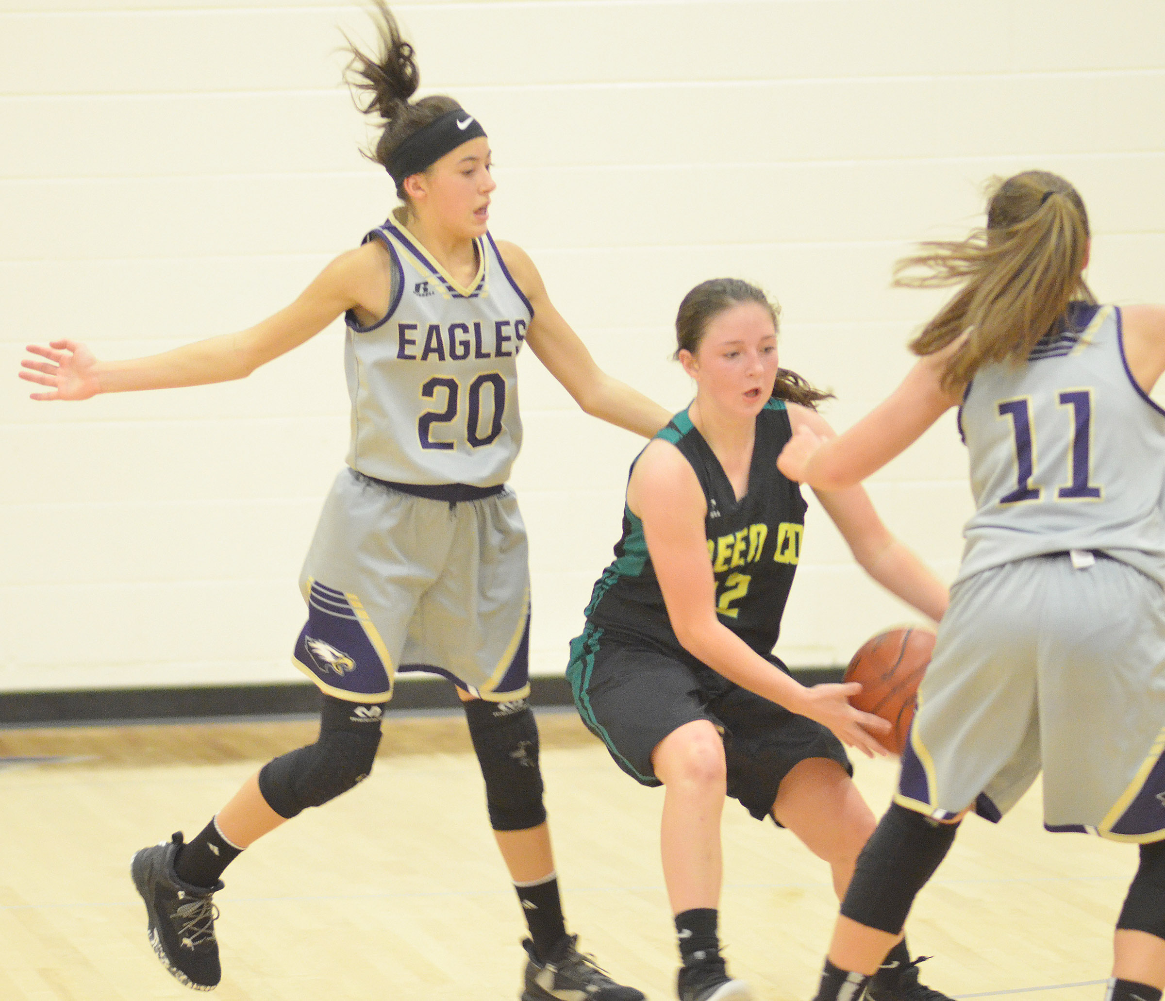 CMS eighth-graders Kaylyn Smith, at left, and Lainey Watson play defense.