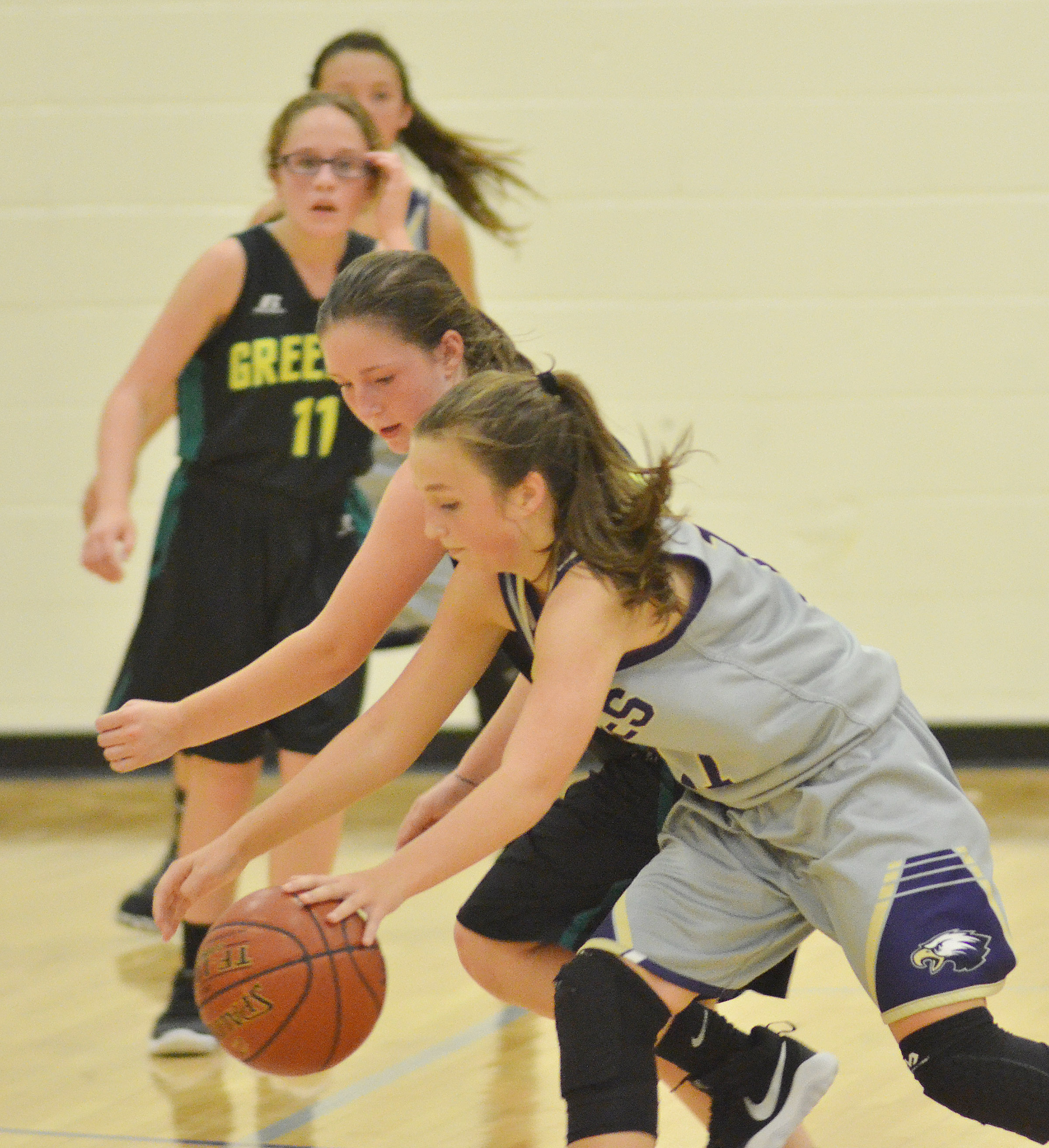 CMS eighth-grader Lainey Watson battles for the ball.