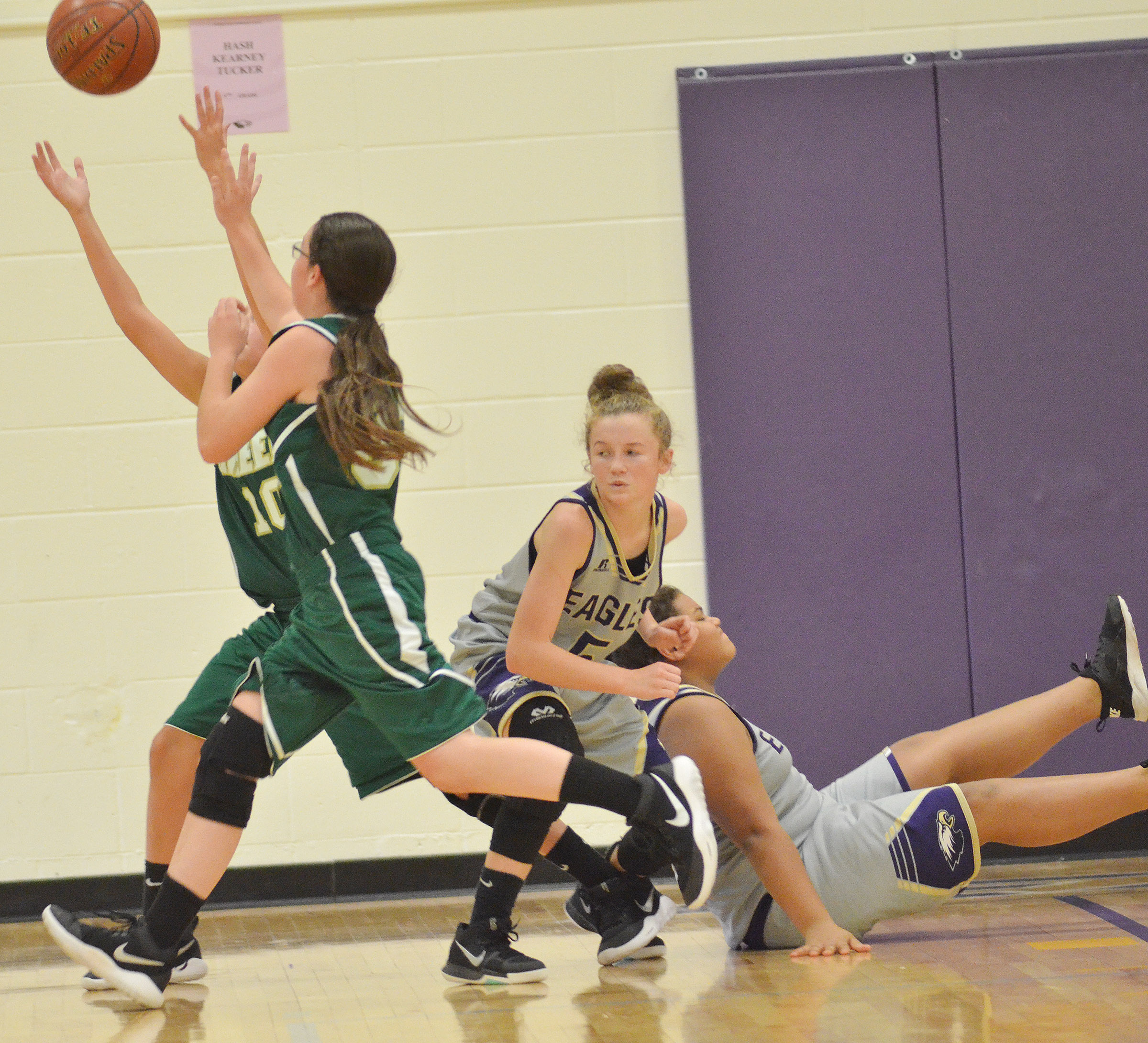 CMS seventh-graders Dakota Slone, at left, and Asia Barbour battle for the ball.