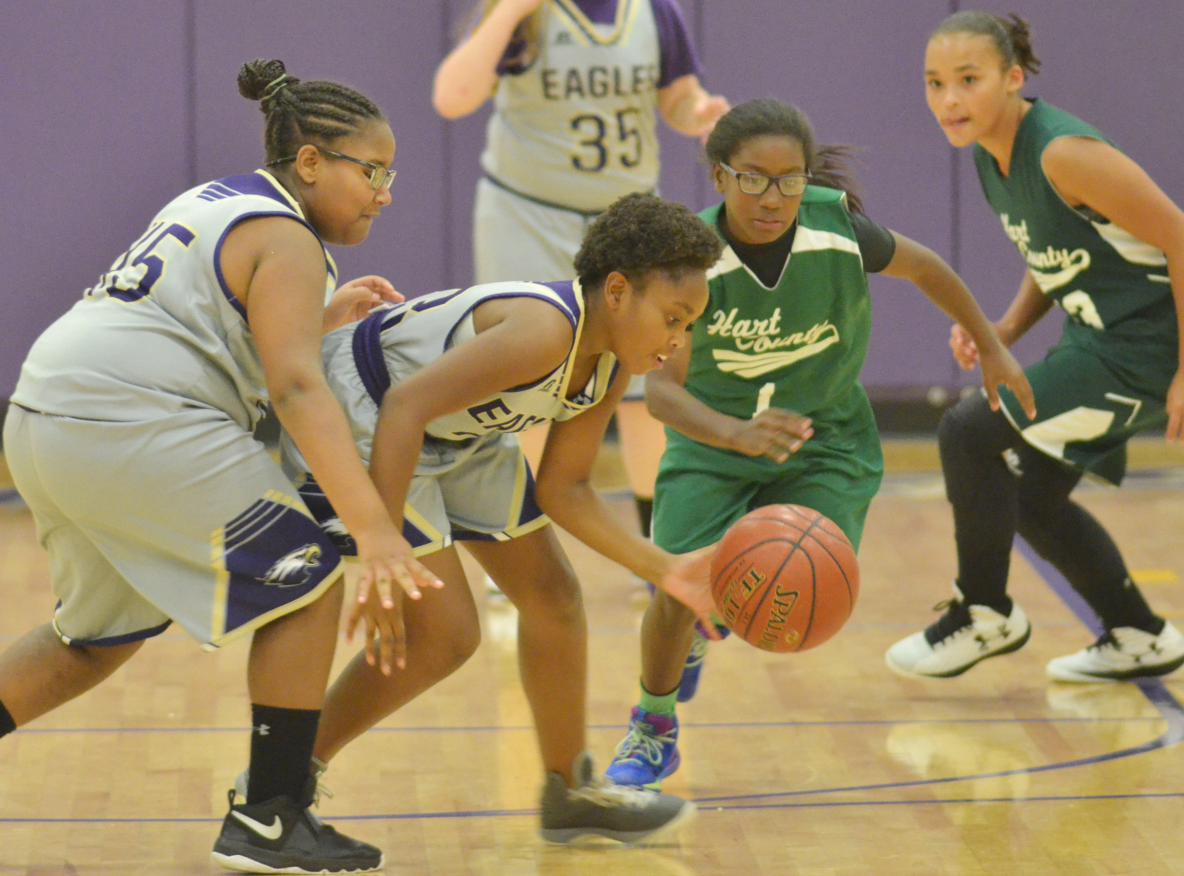 CMS sixth-grader KyAshia Mitchell, at left, and Campbellsville Elementary School fifth-grader Ta'Zaria Owens battle for the ball.
