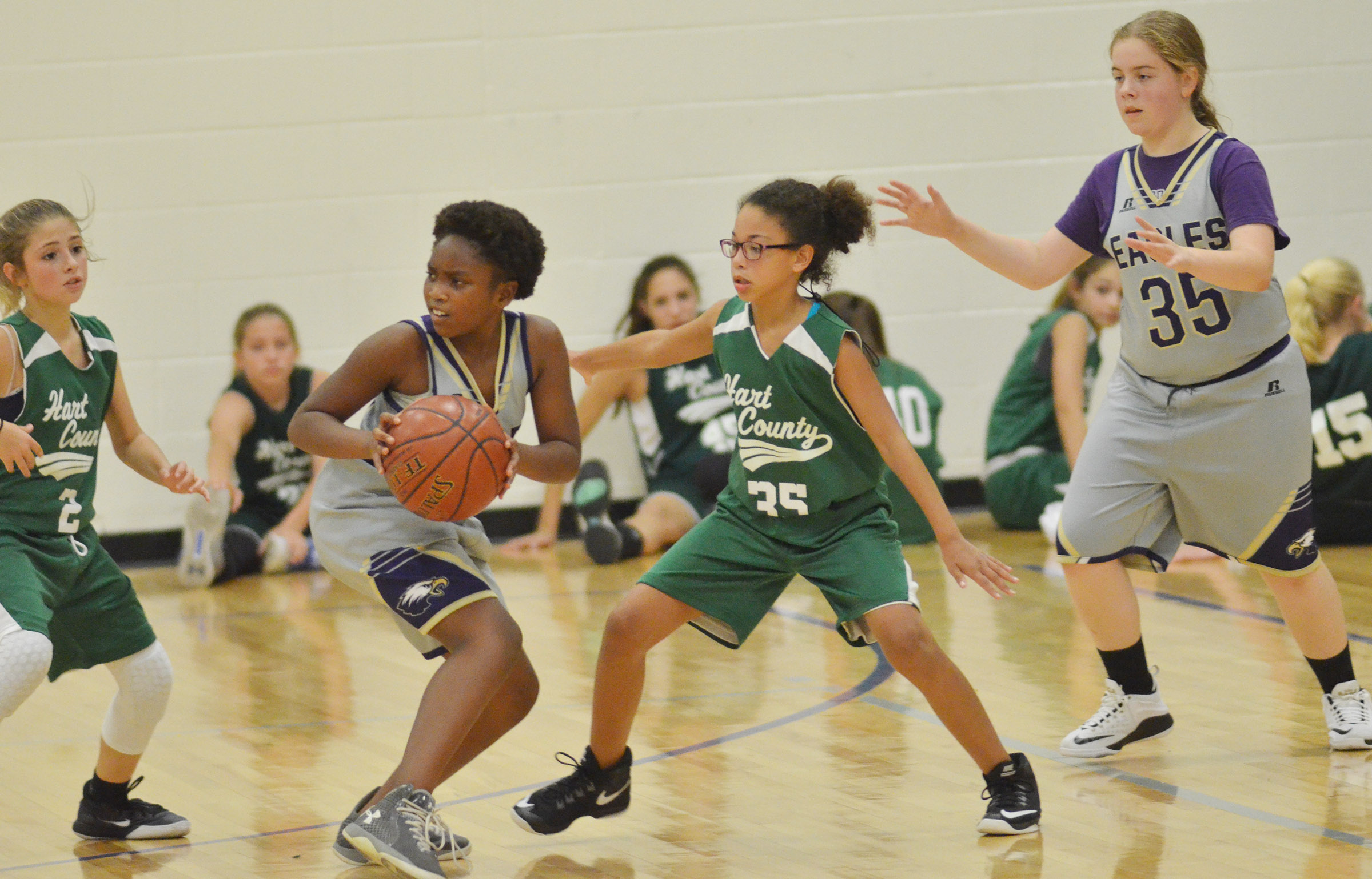 Campbellsville Elementary School fifth-grader Ta'Zaria Owens looks to pass, as CMS sixth-grader Layla Steen calls for the ball.