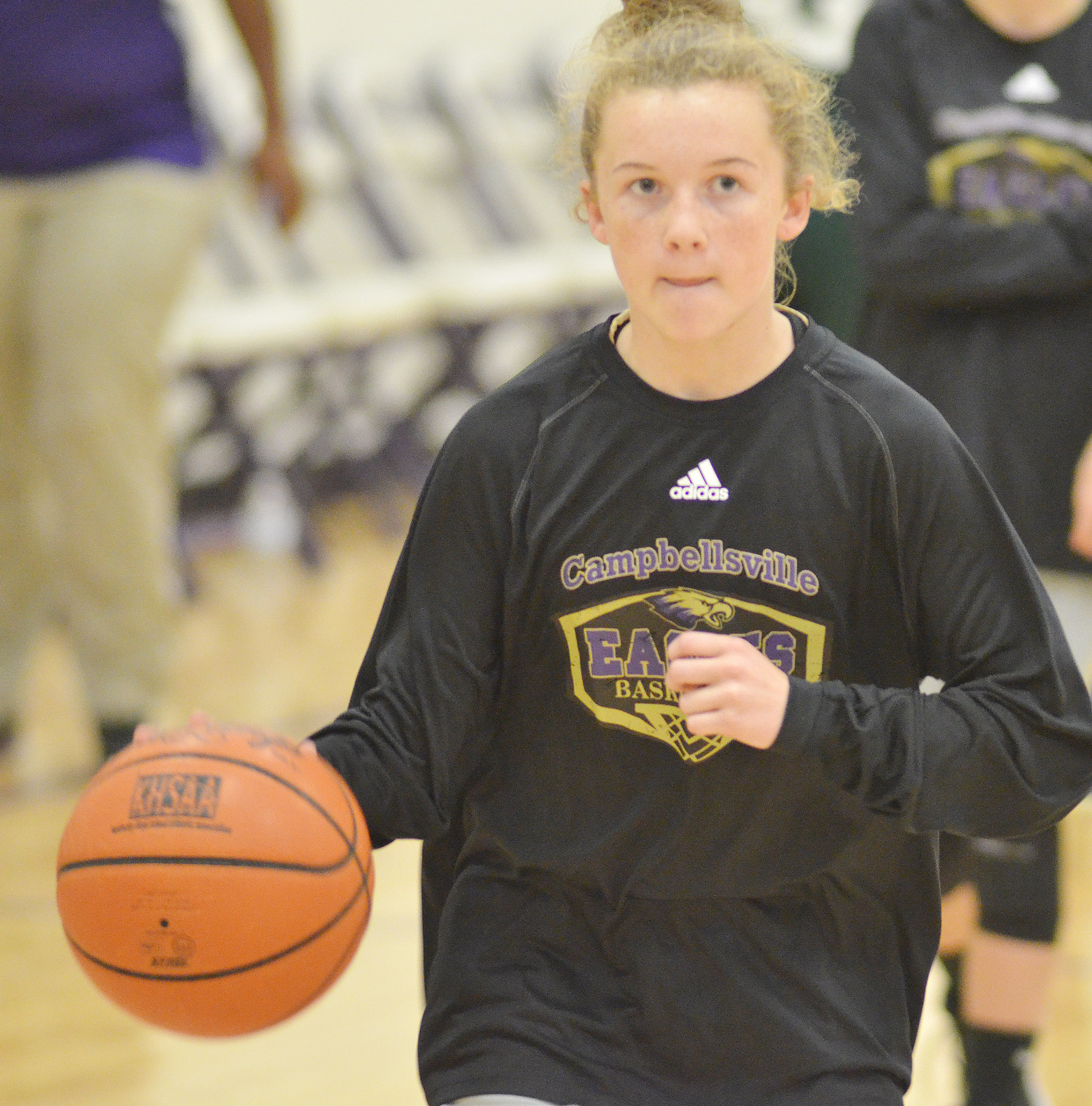CMS seventh-grader Dakota Slone dribbles during warmup.