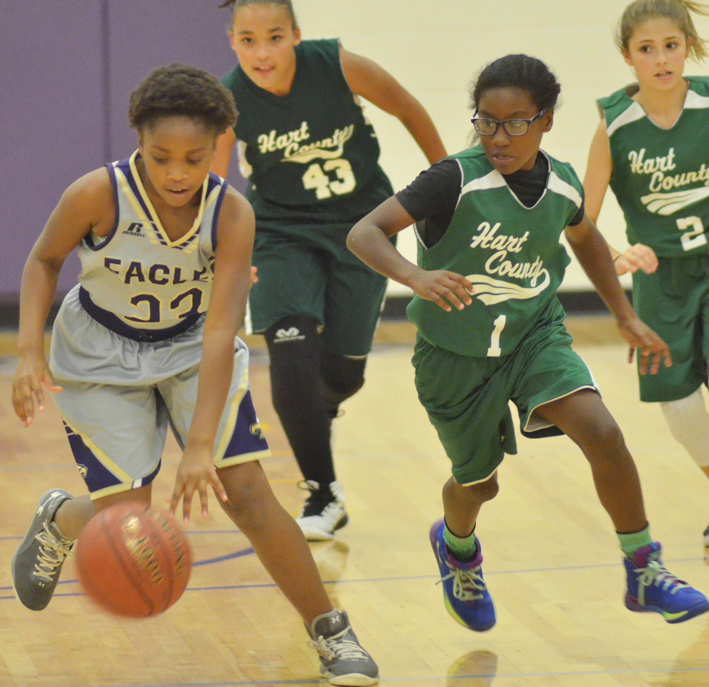 Campbellsville Elementary School fifth-grader Ta'Zaria Owens dribbles to the hoop.