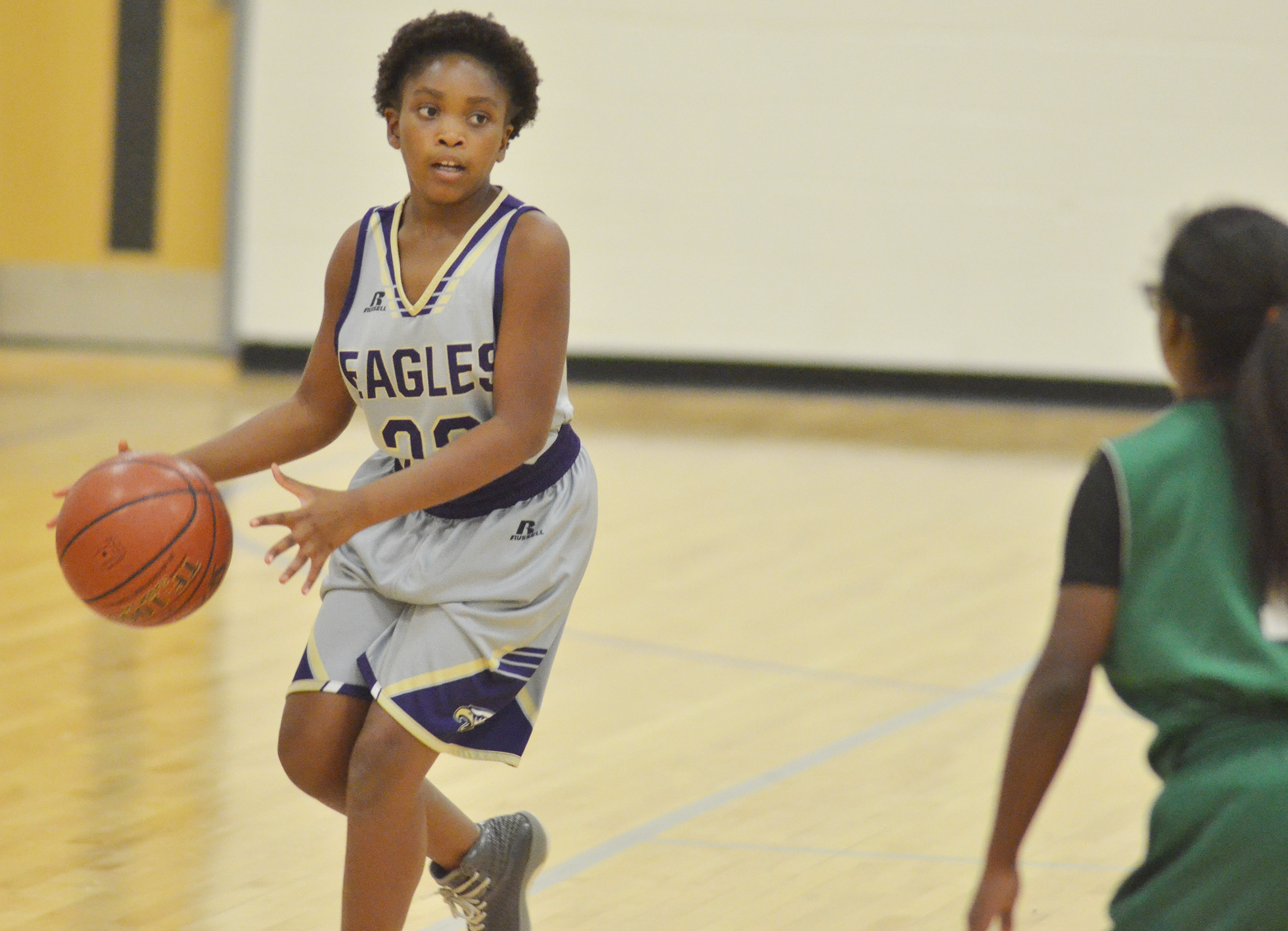 Campbellsville Elementary School fifth-grader Ta'Zaria Owens looks to pass.