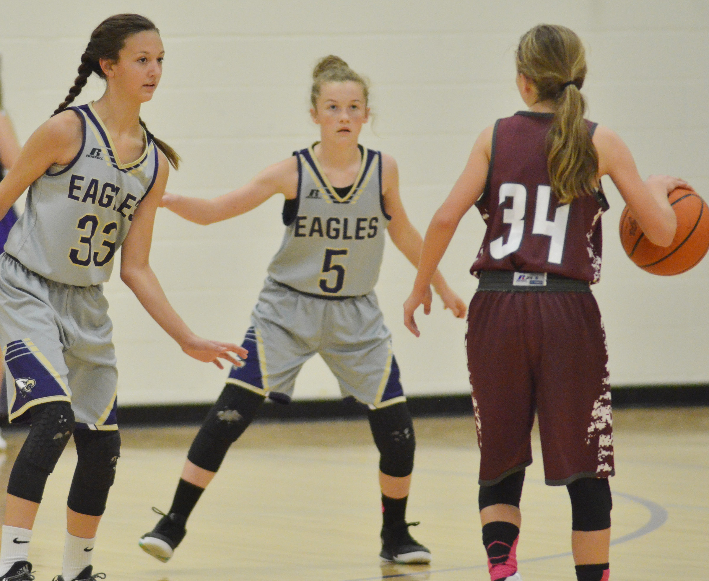 CMS seventh-graders Bri Hayes, at left, and Dakota Slone play defense.