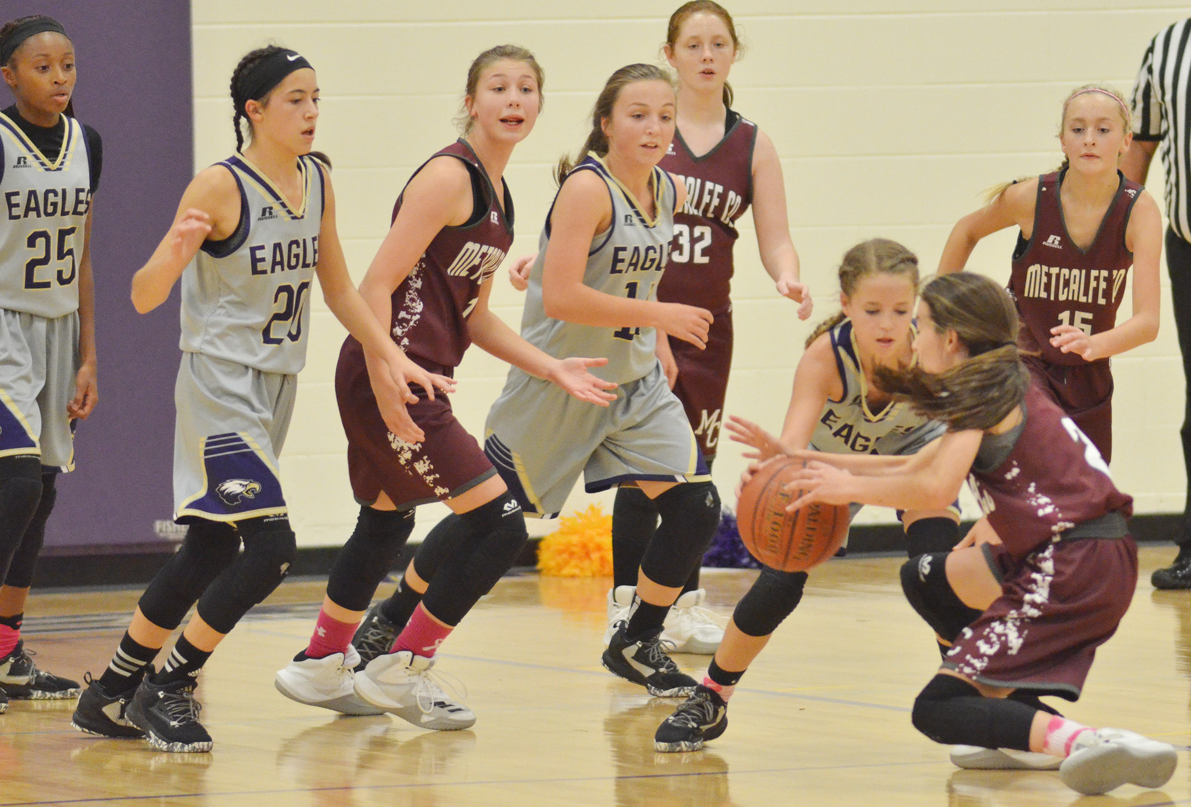 From left, CMS eighth-graders Bri Gowdy, Kaylyn Smith, Lainey Watson and Rylee Petett battle for the ball.