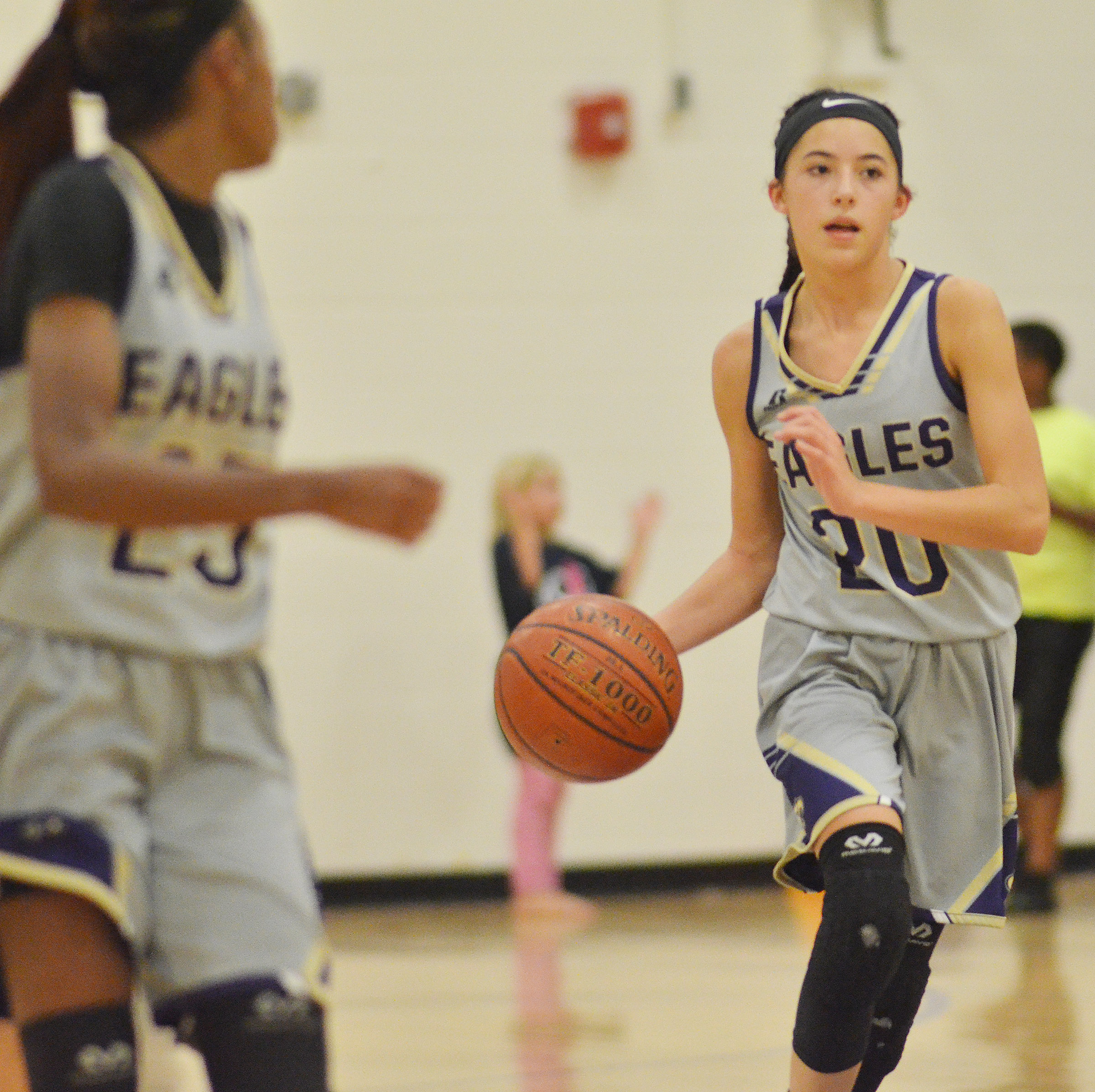 CMS eighth-grader Kaylyn Smith dribbles.