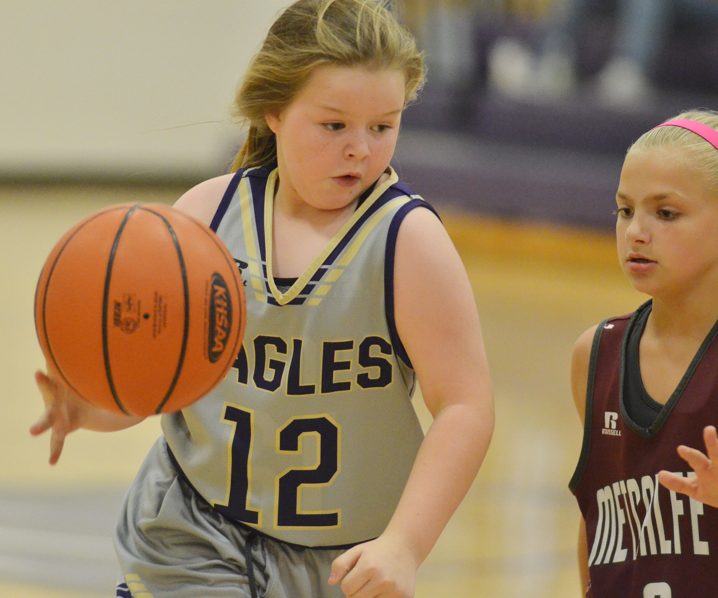 Campbellsville Elementary School fifth-grader Miley Hash dribbles.