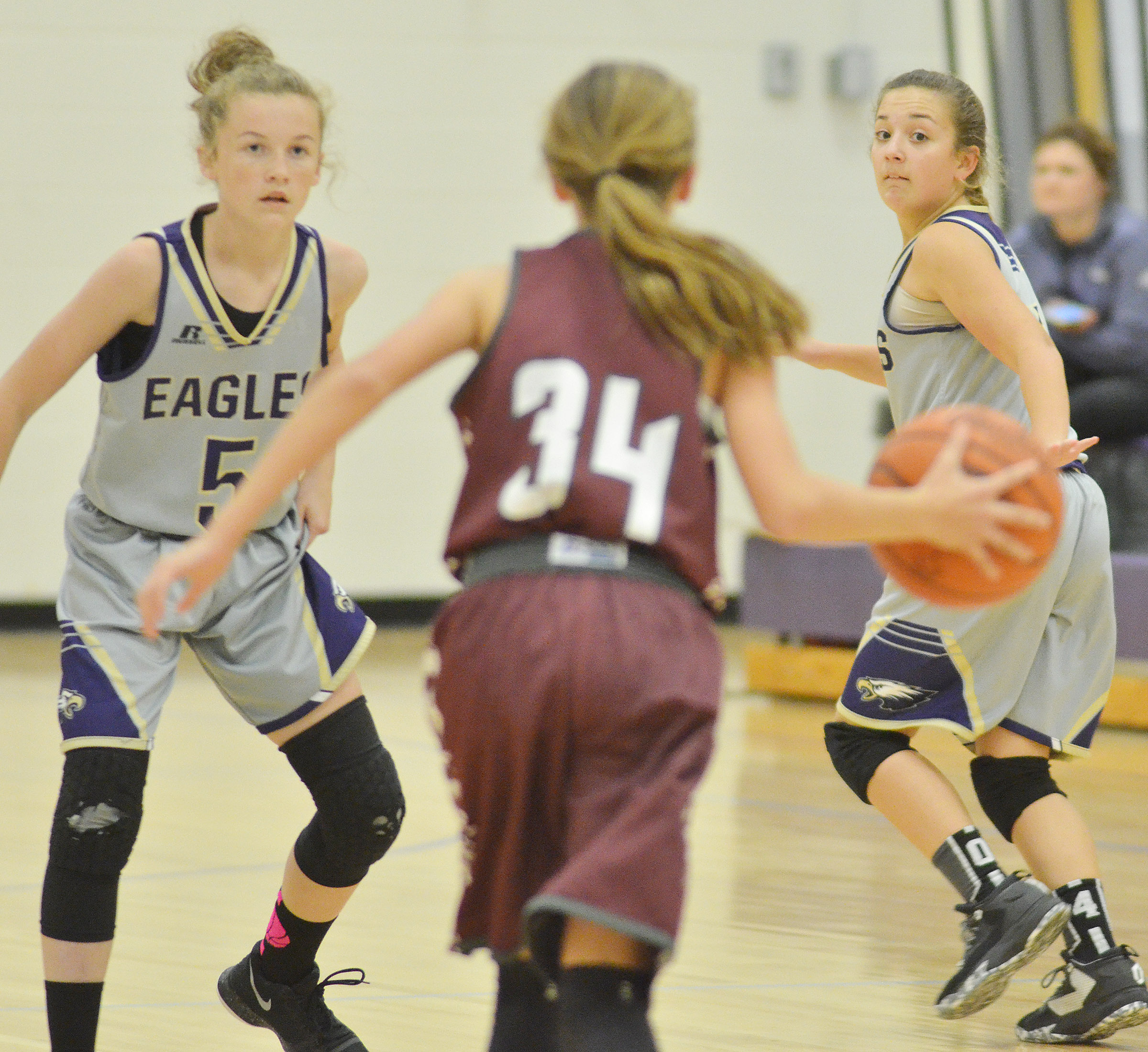CMS seventh-graders Dakota Slone, at left, and Briana Davis play defense.