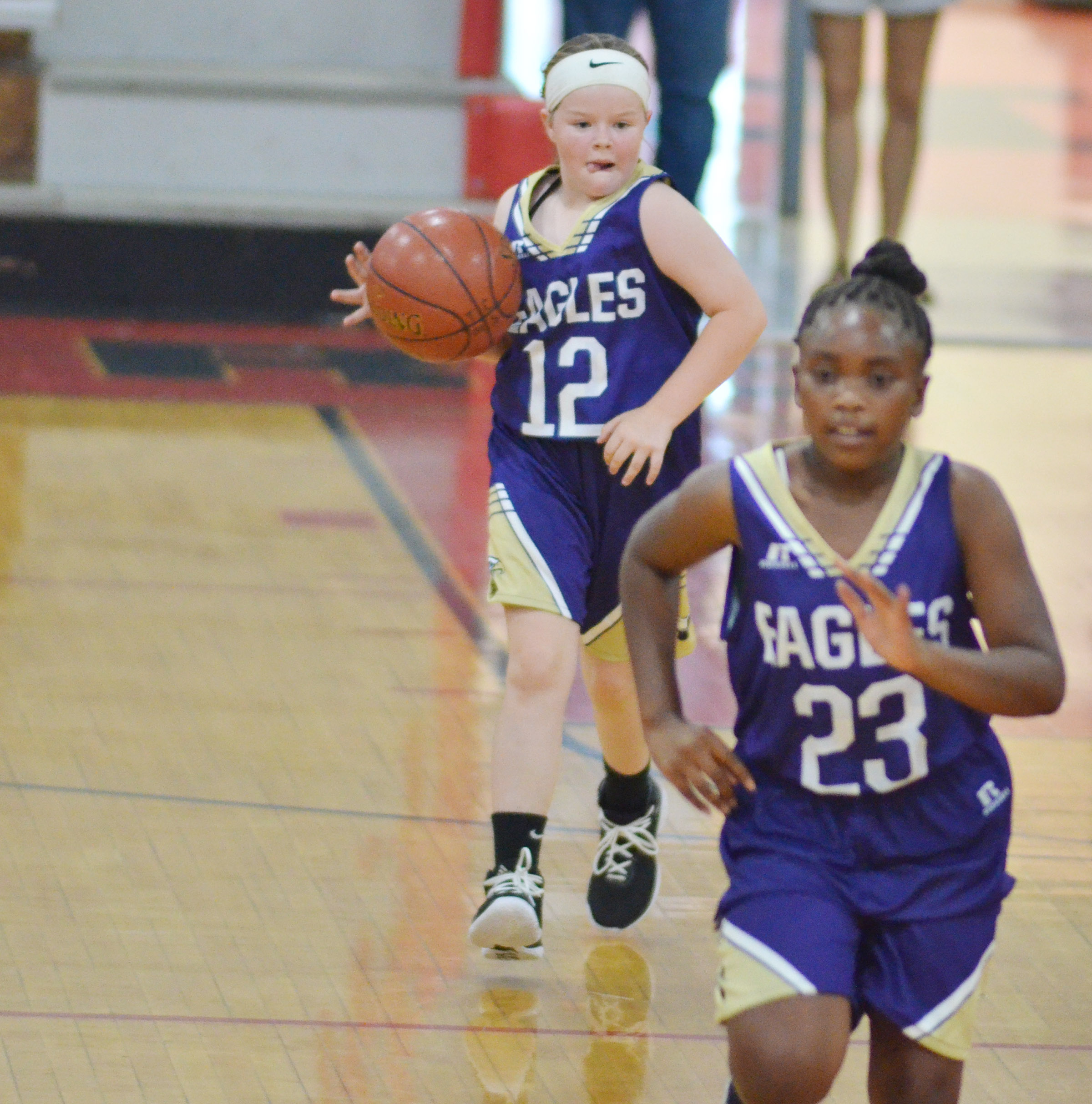 Campbellsville Elementary School fifth-grader Miley Hash dribbles down the court.