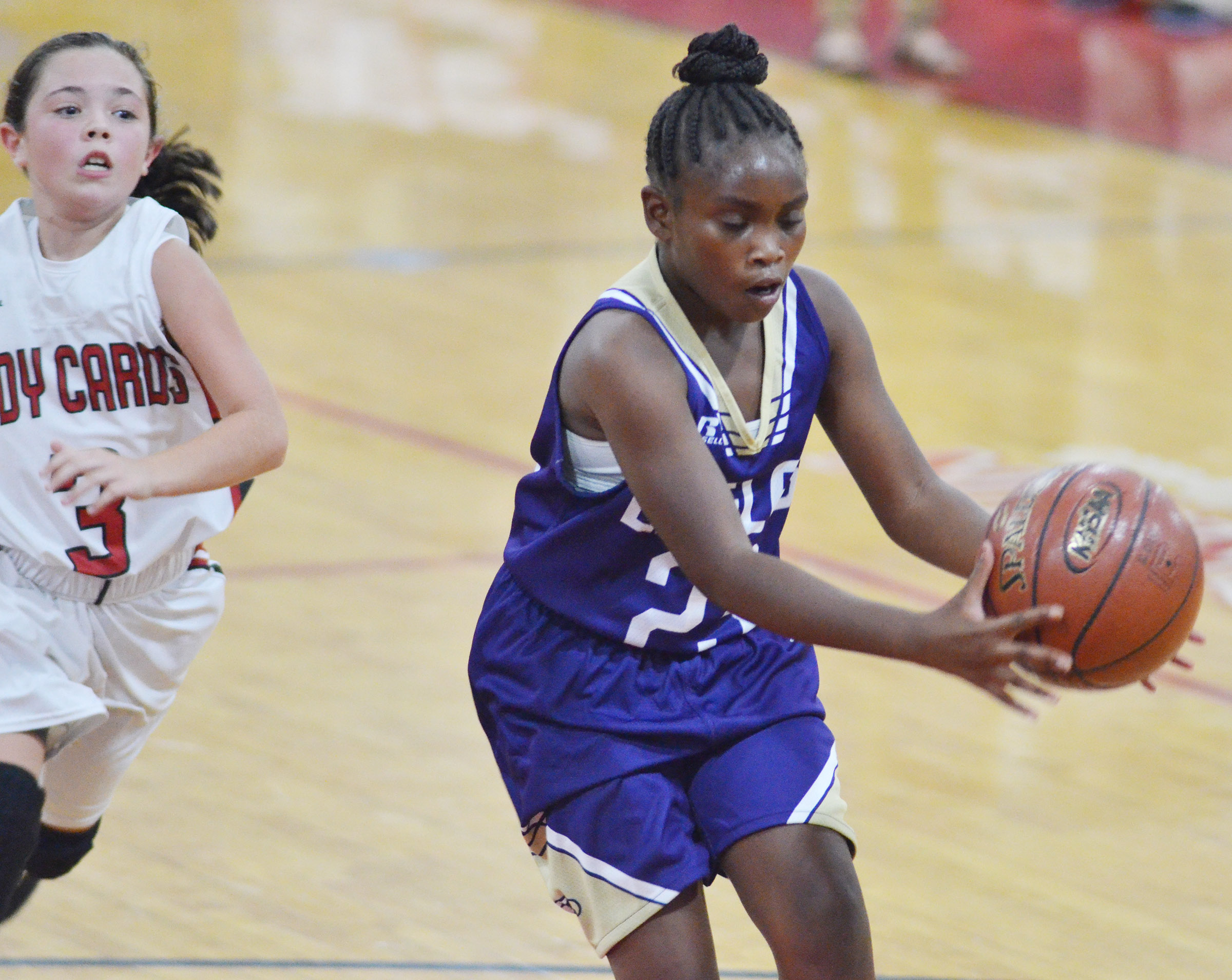 Campbellsville Elementary School fifth-grader Ta'Zaria Owens gets the ball.
