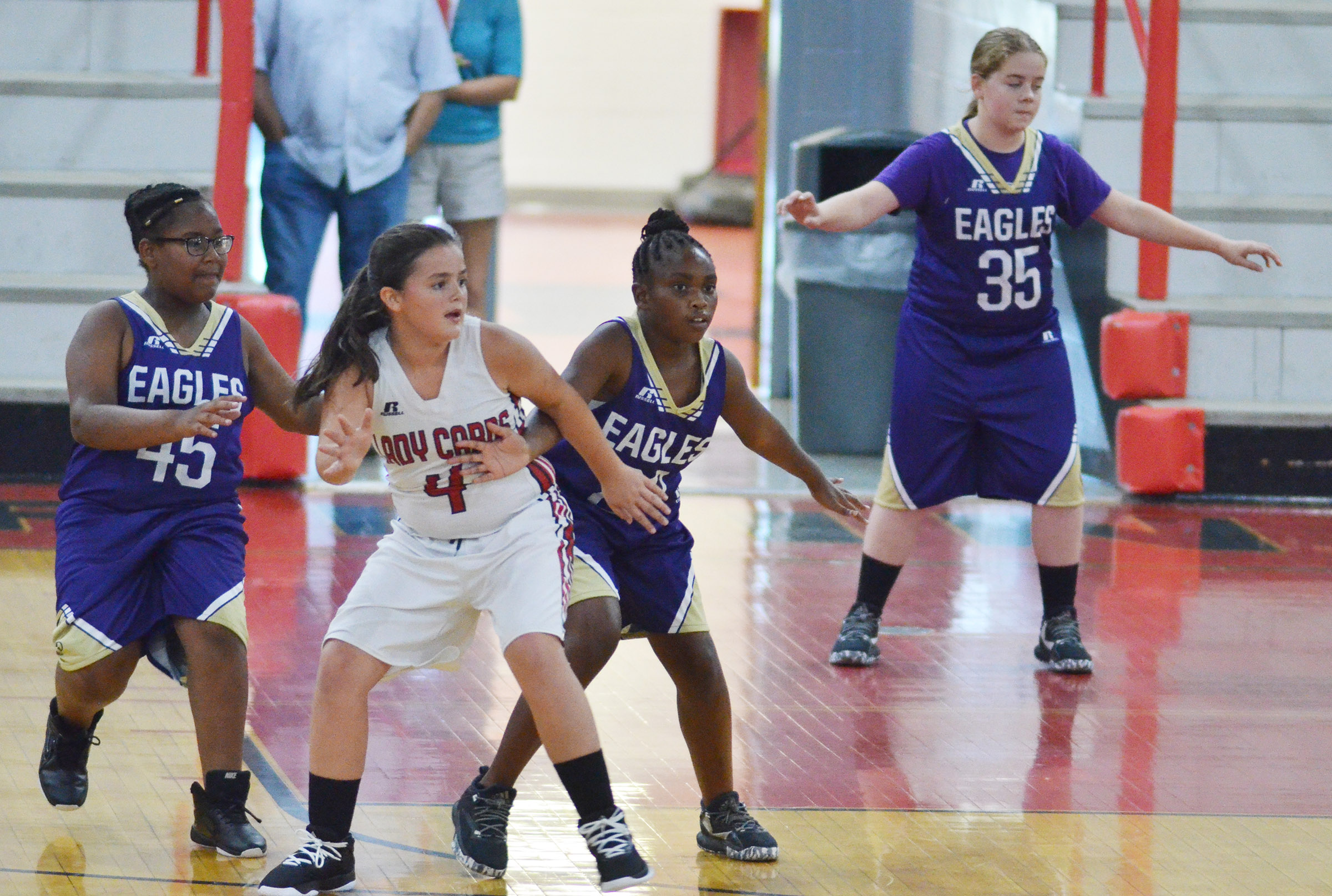 From left, CMS sixth-grader KyAshia Mitchell, Campbellsville Elementary School fifth-grader Ta'Zaria Owens and sixth-grader Layla Steen play defense.