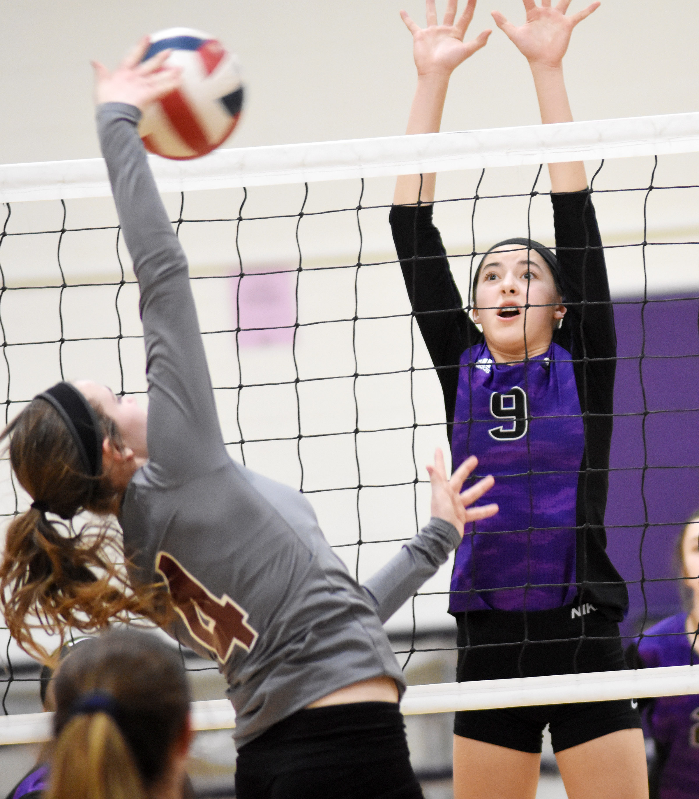 CMS eighth-grader Kaylyn Smith jumps to block a shot.