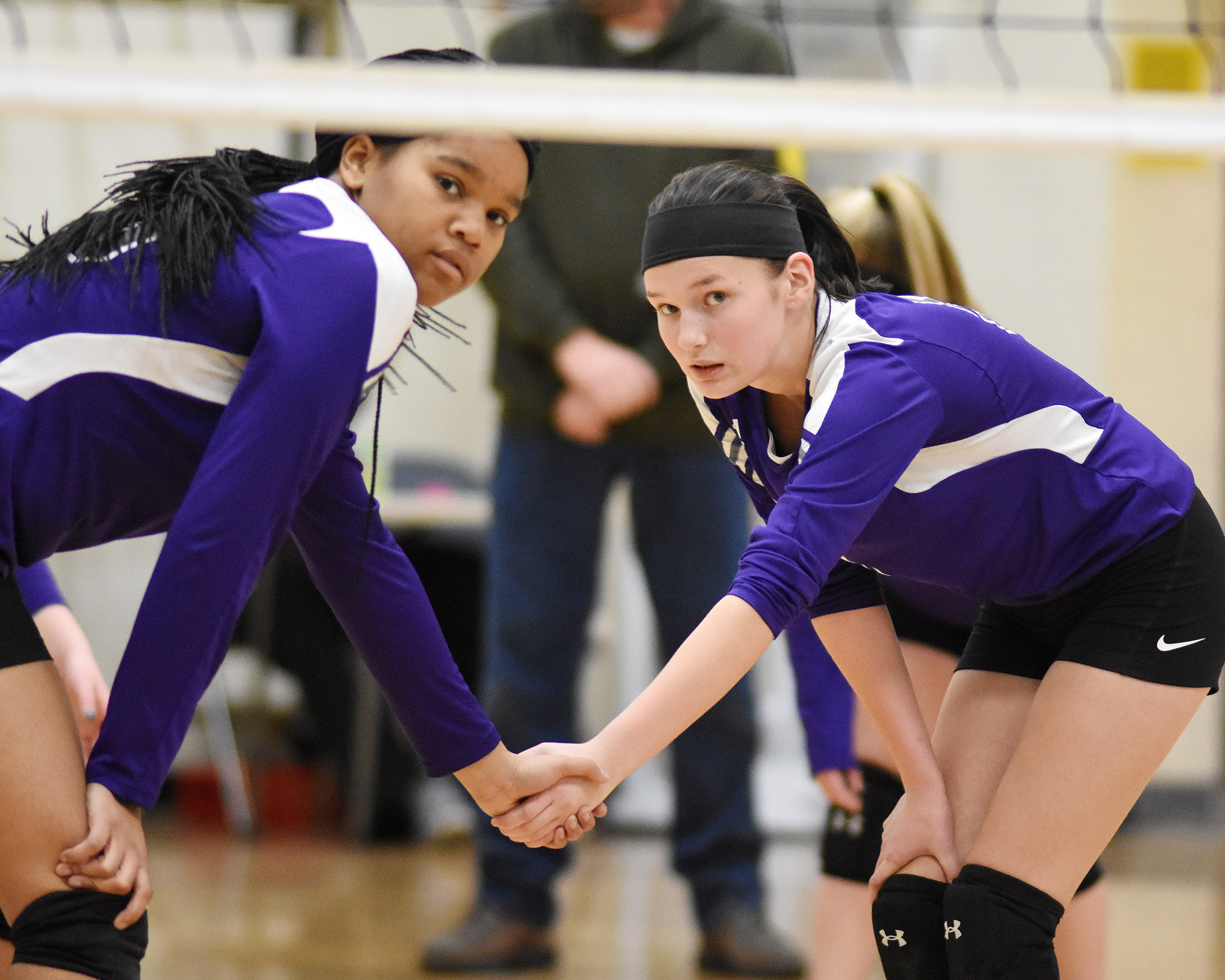 CMS seventh-graders Antaya Epps, at left, and BreAnna Humphress get ready for the serve.