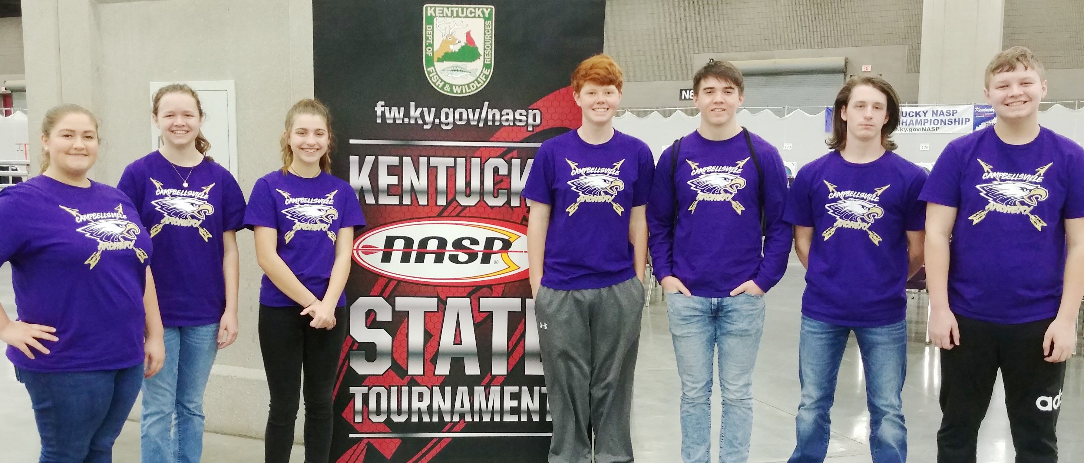 From left, CHS junior Aleah Knifley, freshman MaCayla Falls, CMS seventh-grader Braelyn Price, sophomore Colin Harris, junior Cole Kidwell, eighth-grader Seth Hash and seventh-grader Hunter Falls compete at the state NASP archery shoot.