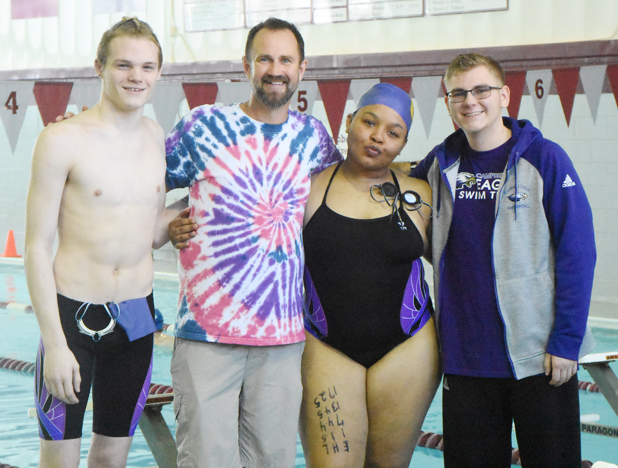 CHS senior swim team members were recently honored for their dedication to their team. From left are Joe Pipes, coach Steve Doss, Natalie Caldwell and Brandon Greer.