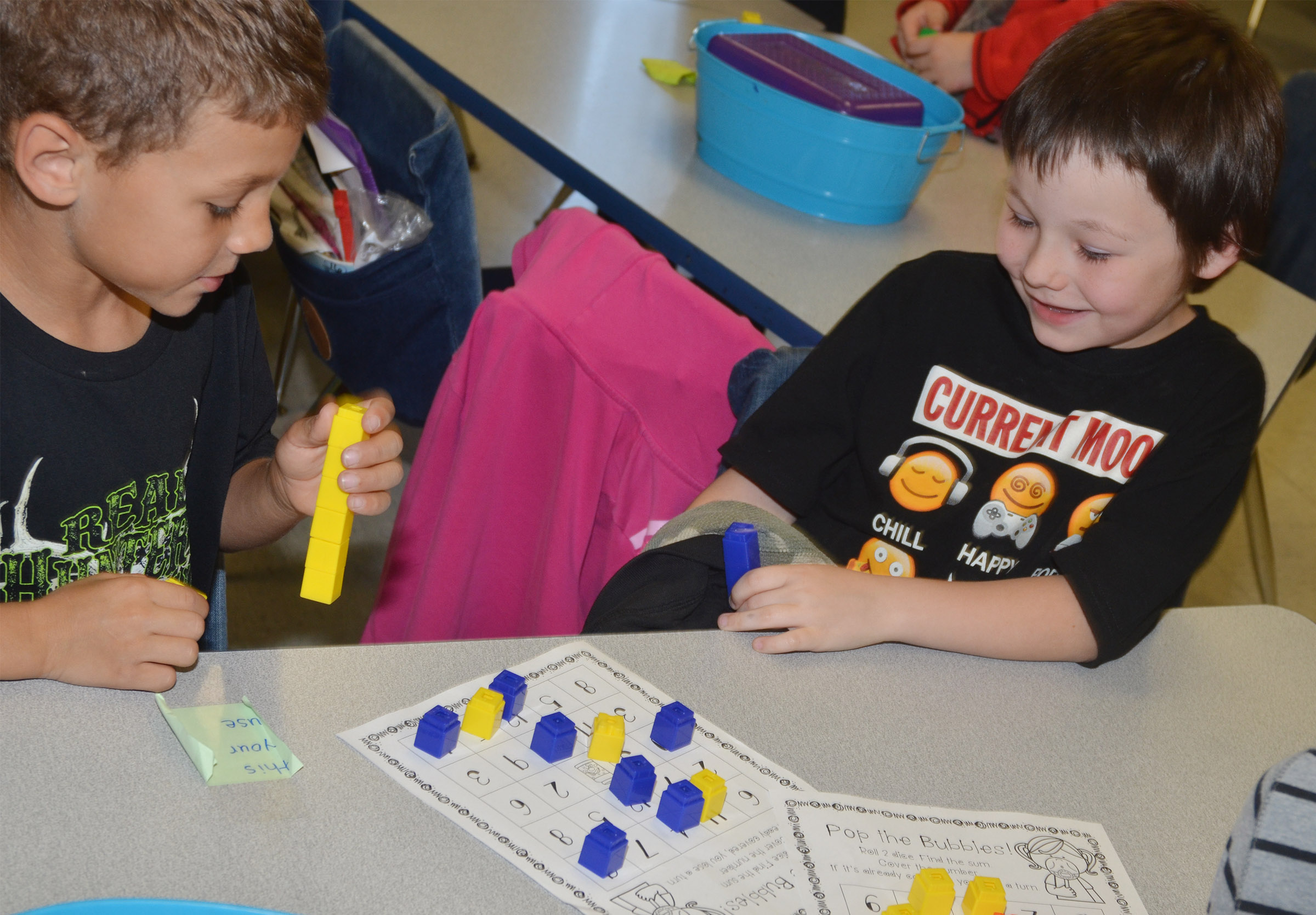 CES first-graders Shylan Dunn, at left, and Joseph Boudreaux play a Pop the Bubble counting game.