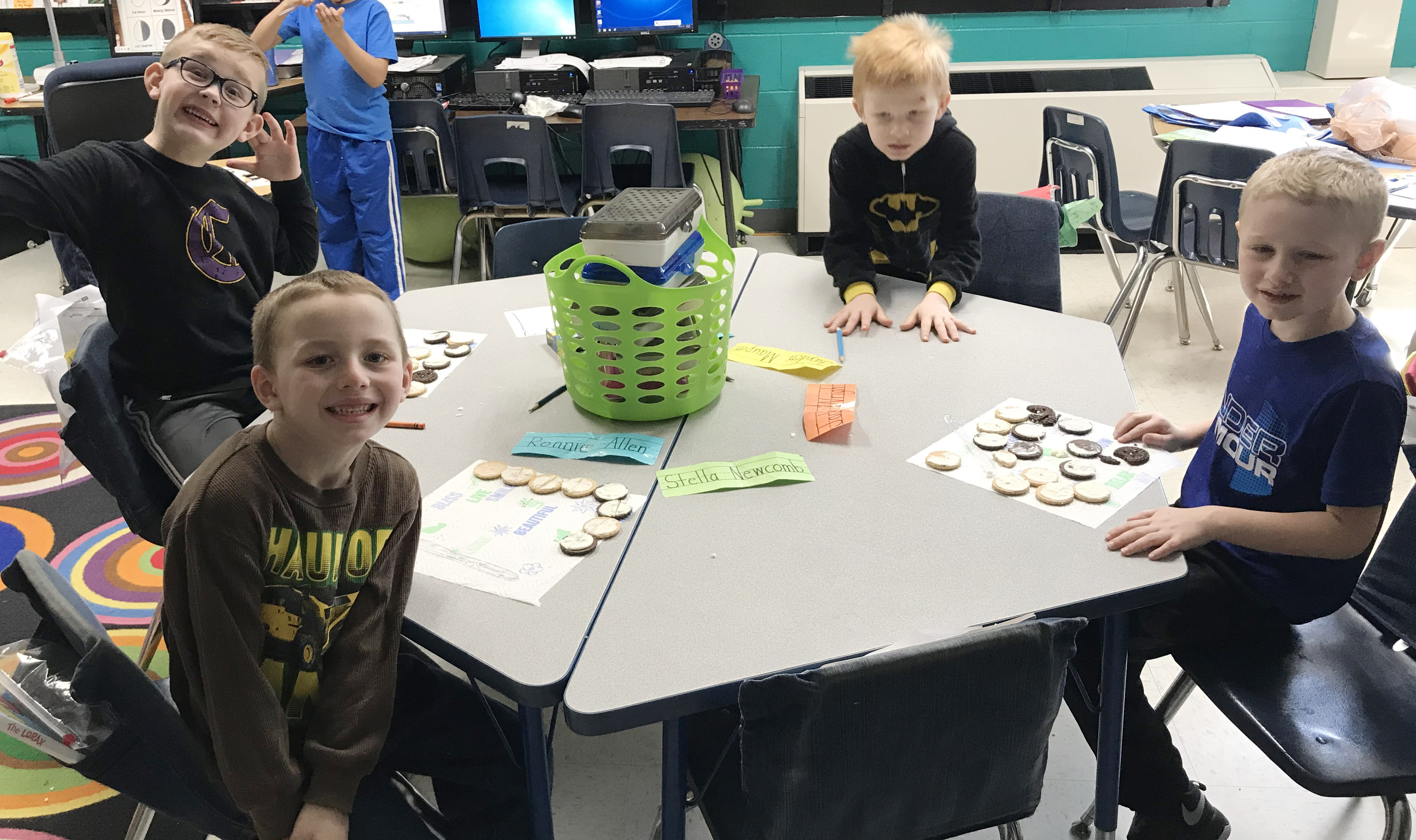 CES first-graders Ronnie Allen, John Hagan Newton, Jayden Maupin and Jackson Wright make the phases of the moon by using cream filled cookies.