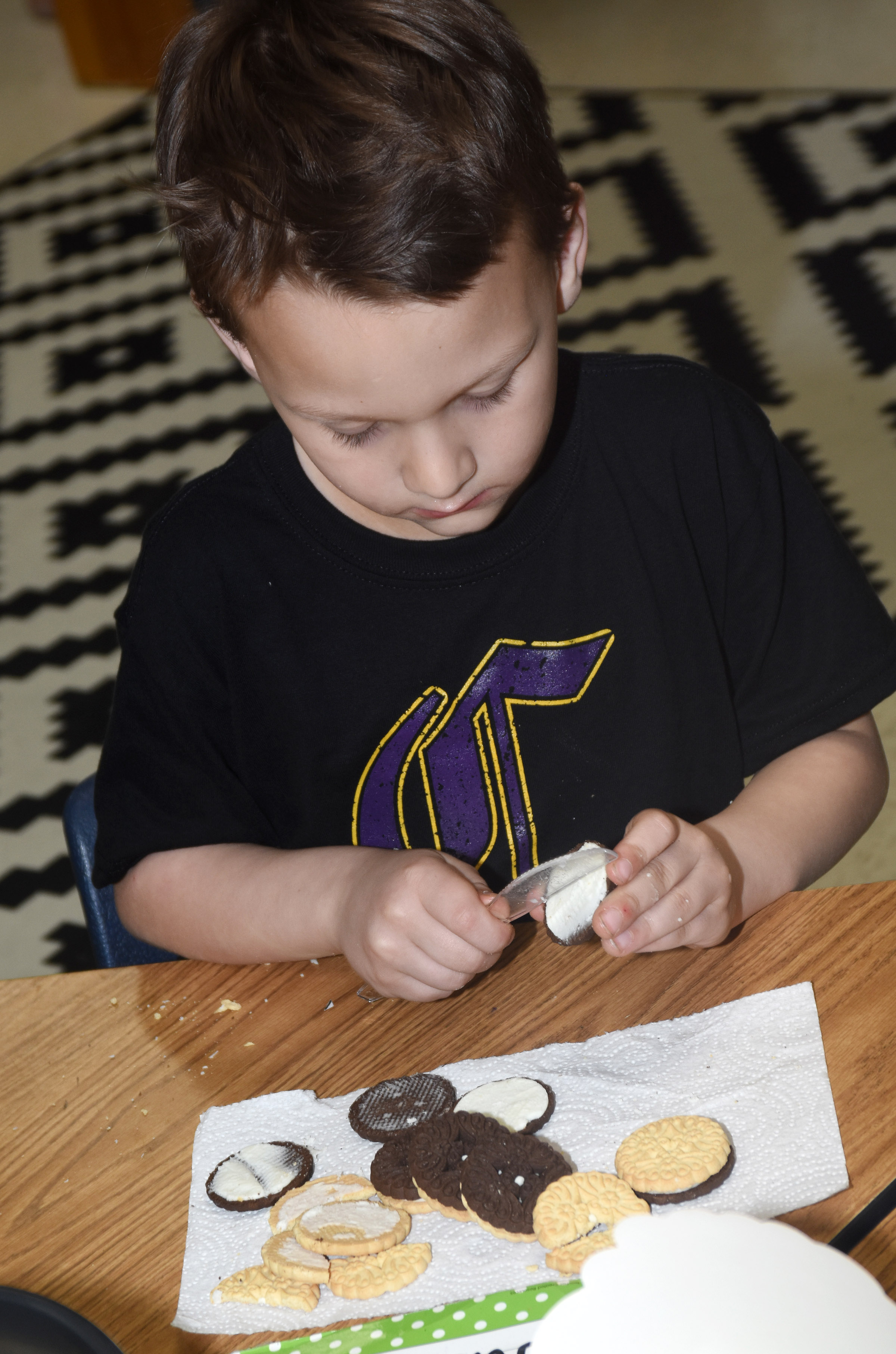 CES first-grader Justice Nelson makes the phases of the moon by using cream filled cookies.