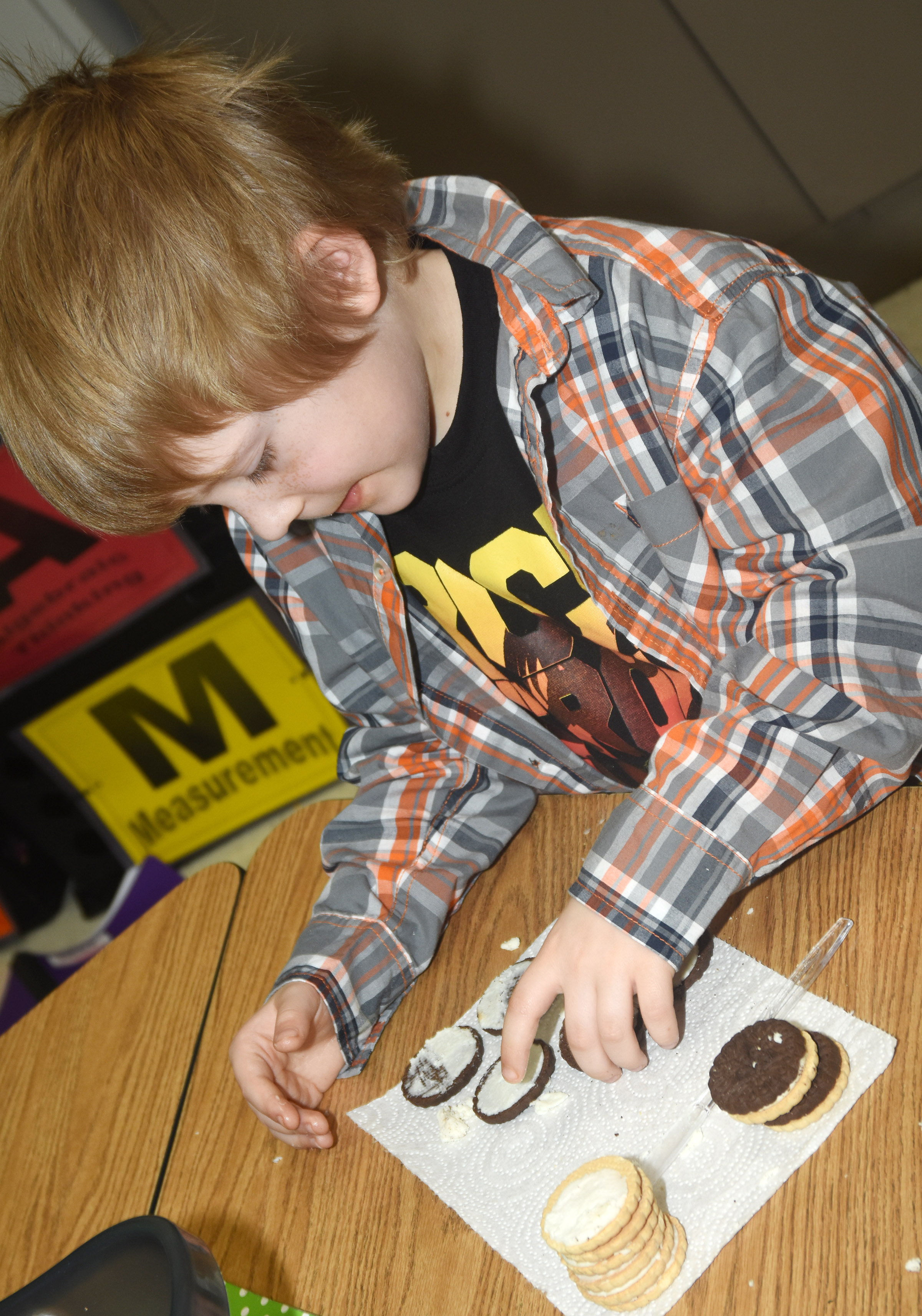 CES first-grader Gage Henderson makes the phases of the moon by using cream filled cookies.
