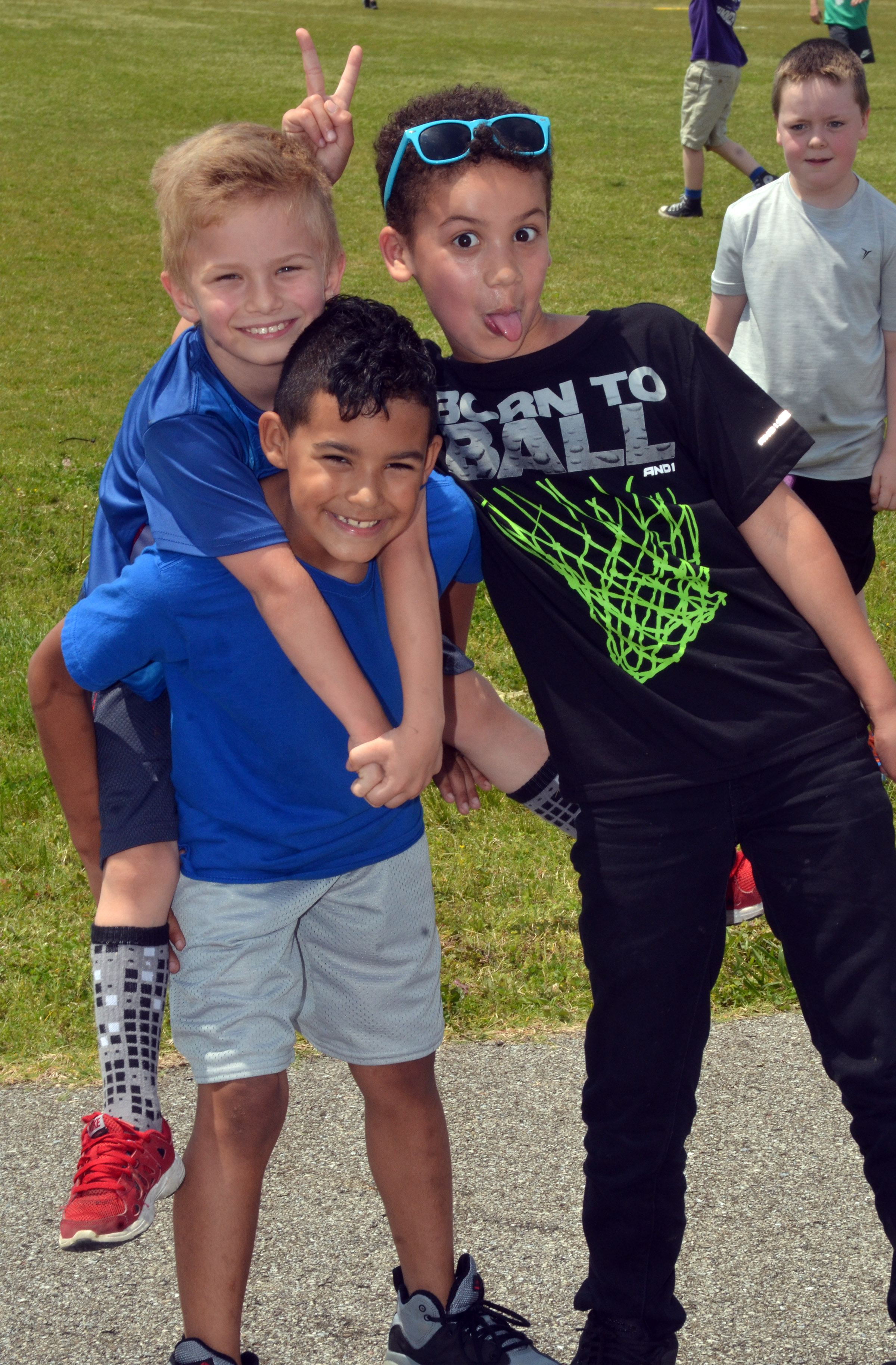 CES first-graders Parker Hamilton, on Rizzo McKenzie's shoulders, and Bryant Mayo have fun together.