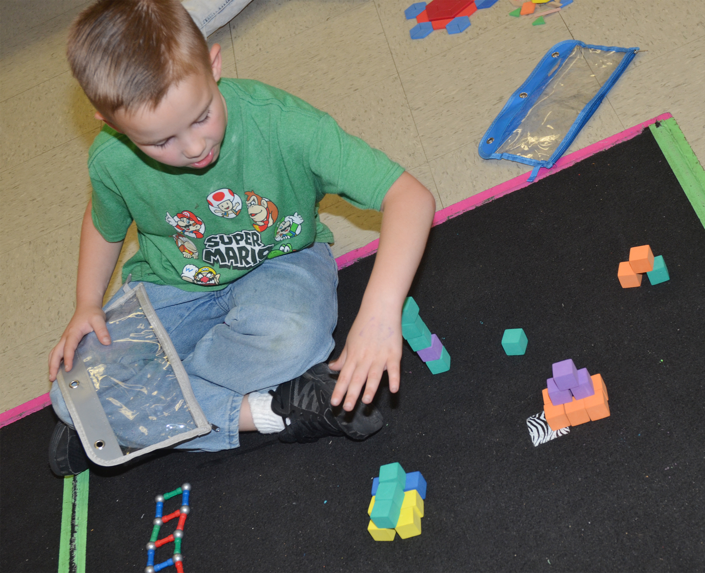CES first-grader Jackson Bates builds with shapes.