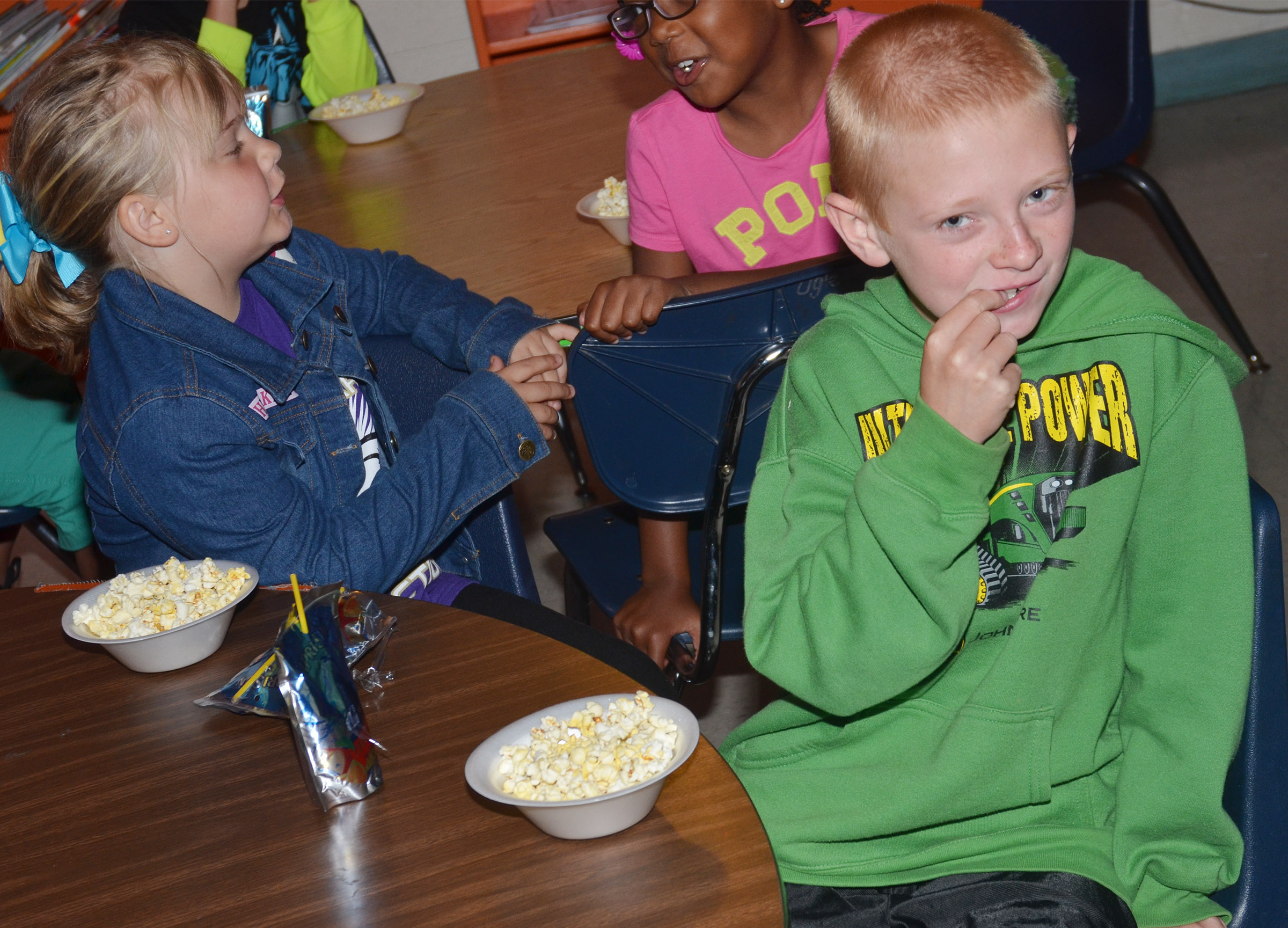 CES first-grader Jacob Wethington enjoys his popcorn snack.