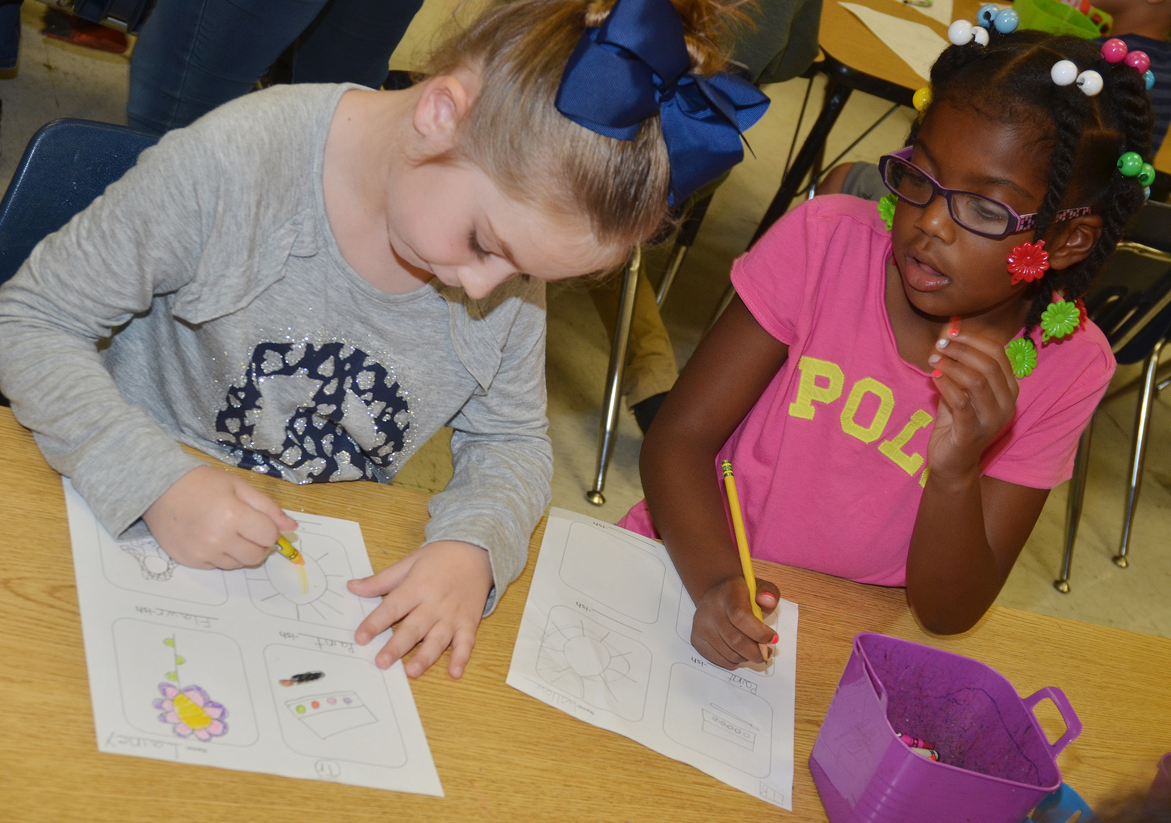 "CES second-graders Lainey Price, at left, and Willow Griffin create their ""-ish"" drawings."