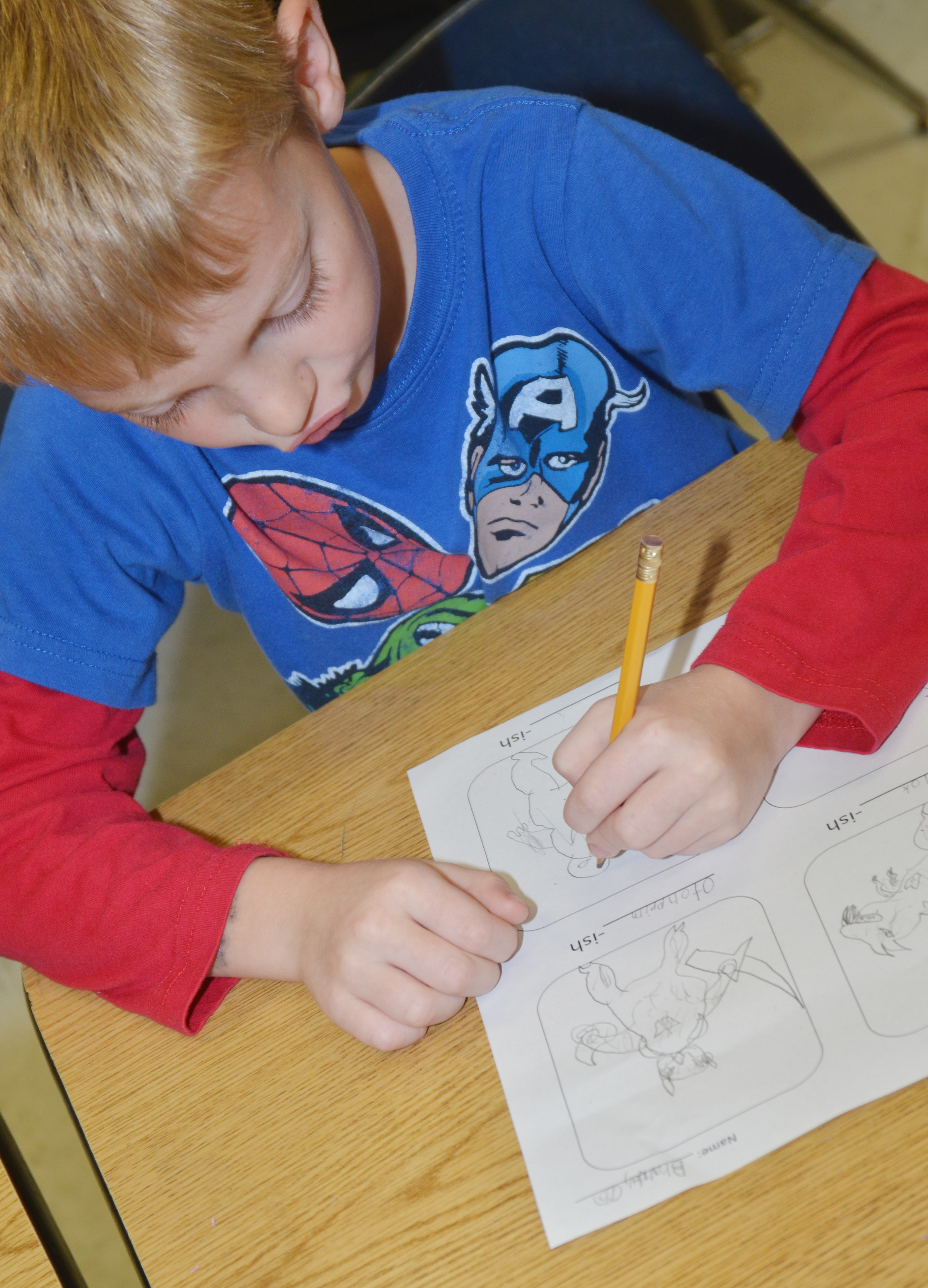 "CES second-grader Brandon Thompson creates his ""-ish"" drawings."