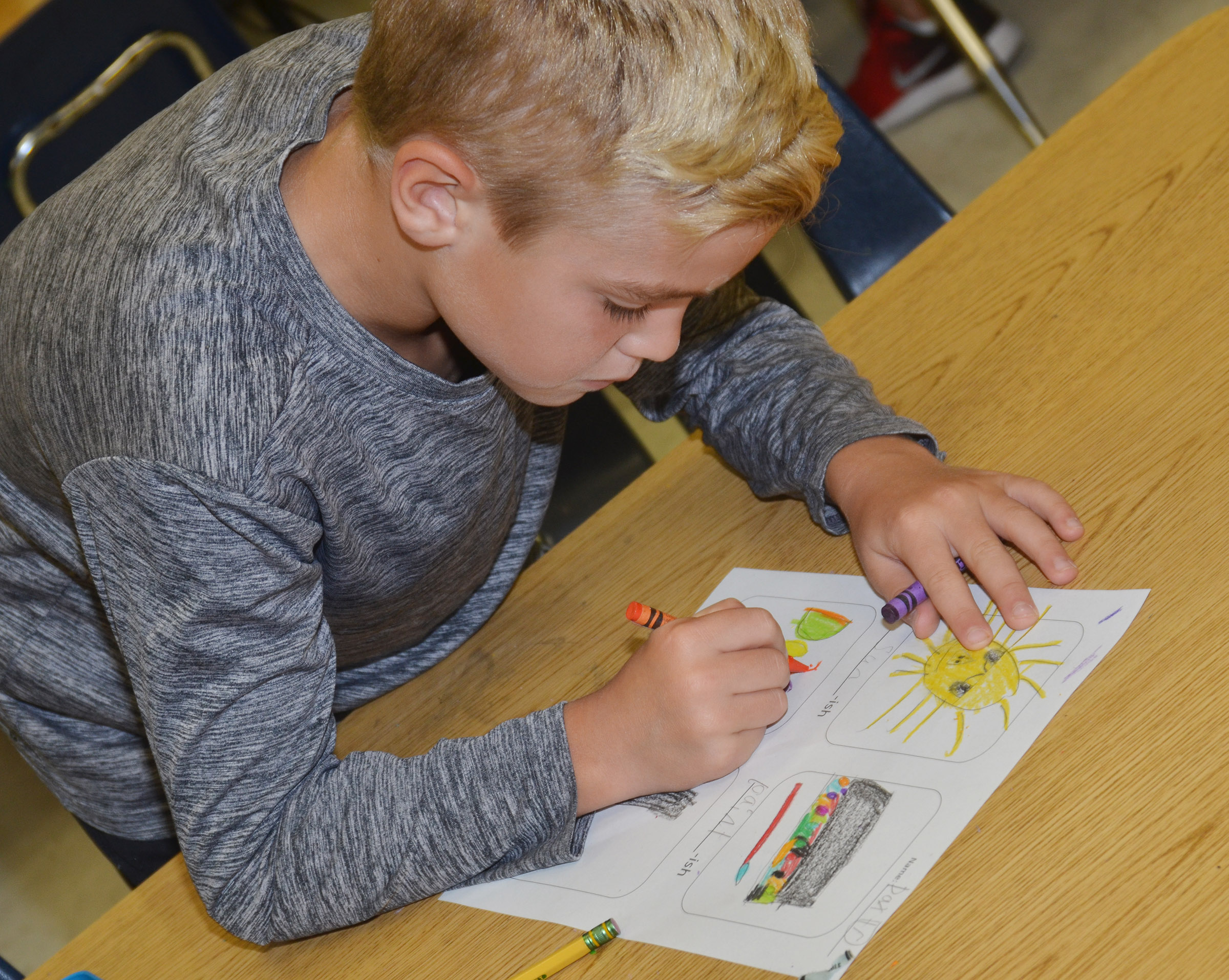 "CES second-grader Dax Gray colors his ""-ish"" drawings."