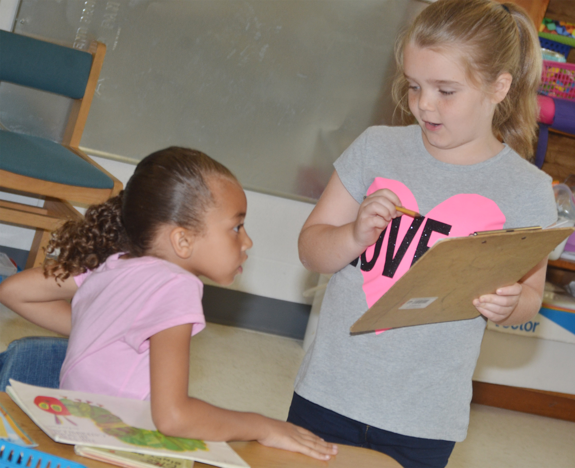 CES second-grader Jaylin Christie interviews first-grader Londyn Smith.