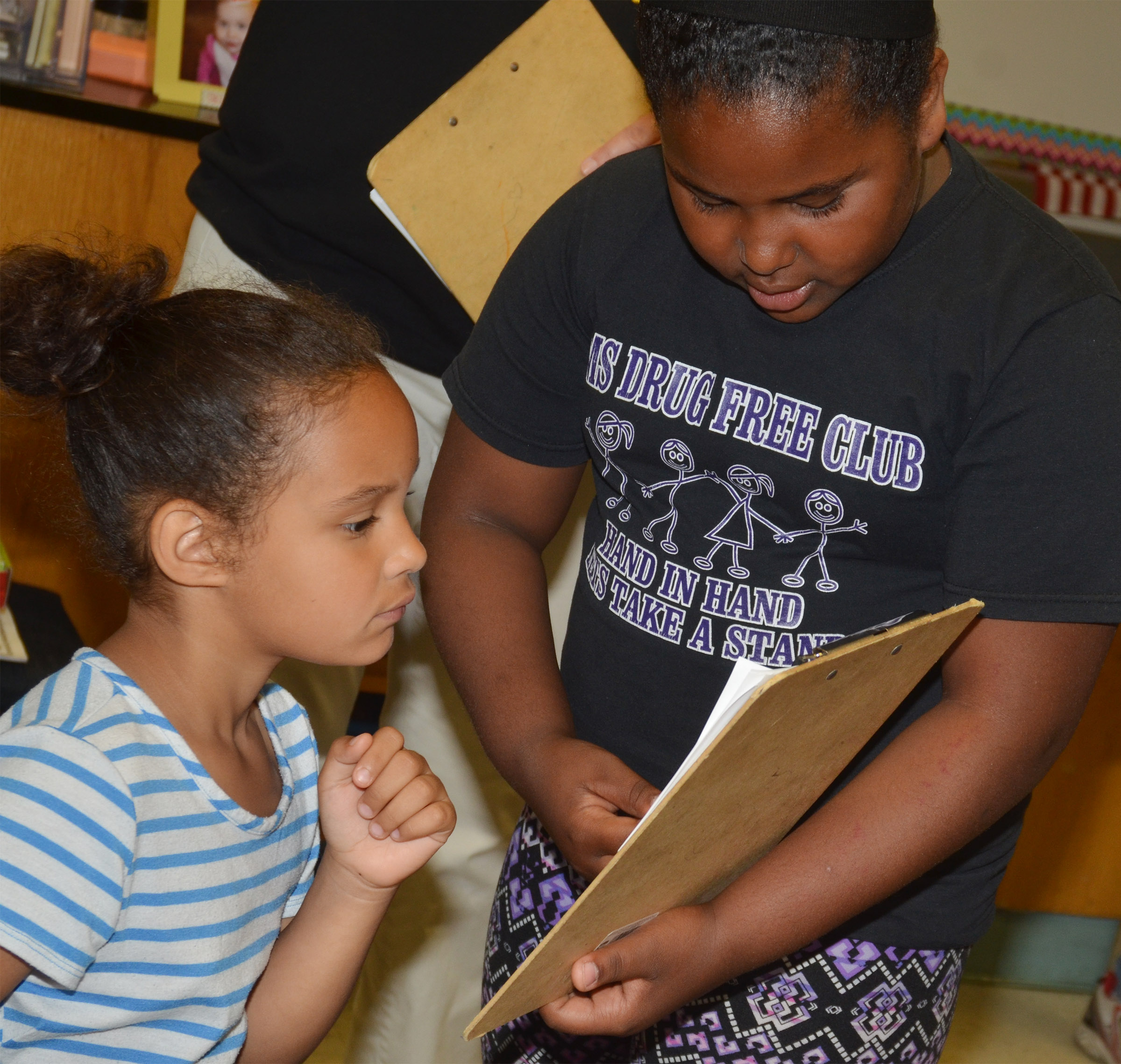 CES second-grader Ajada Smith interviews first-grader Amani Bridgewater.