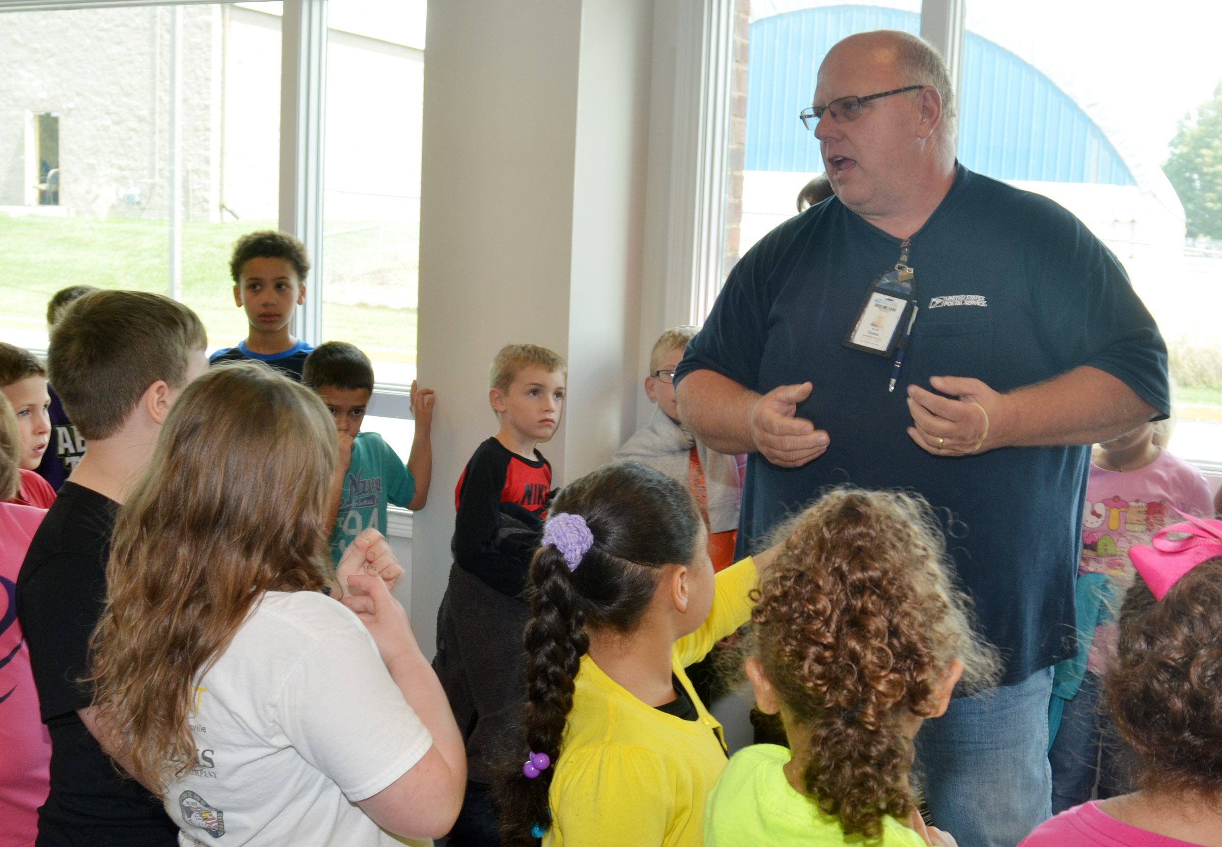Campbellsville Post Office employee Scott Darst explains to CES second-graders how mail gets to post office boxes.