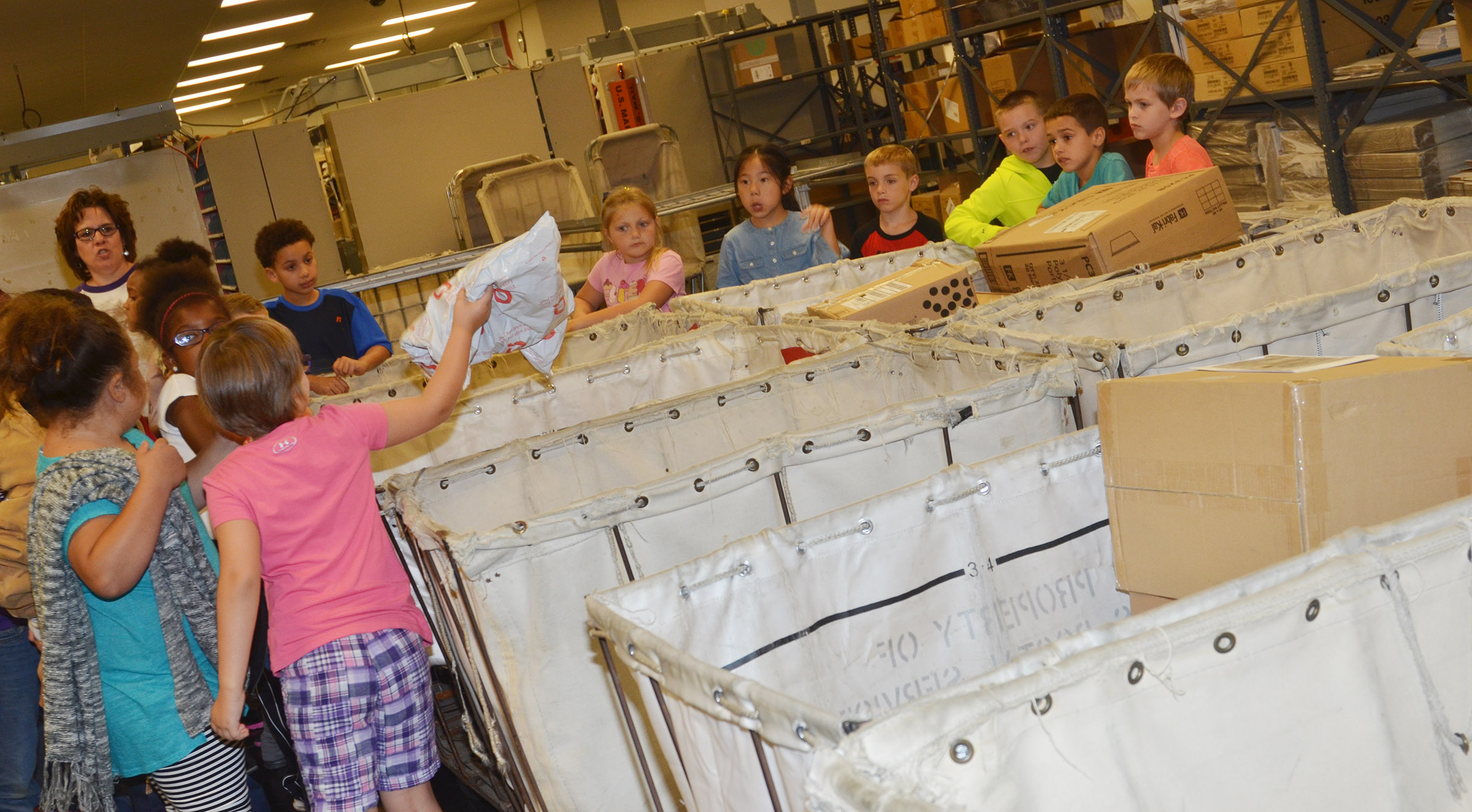 CES second-graders sort packages at the Campbellsville Post Office.