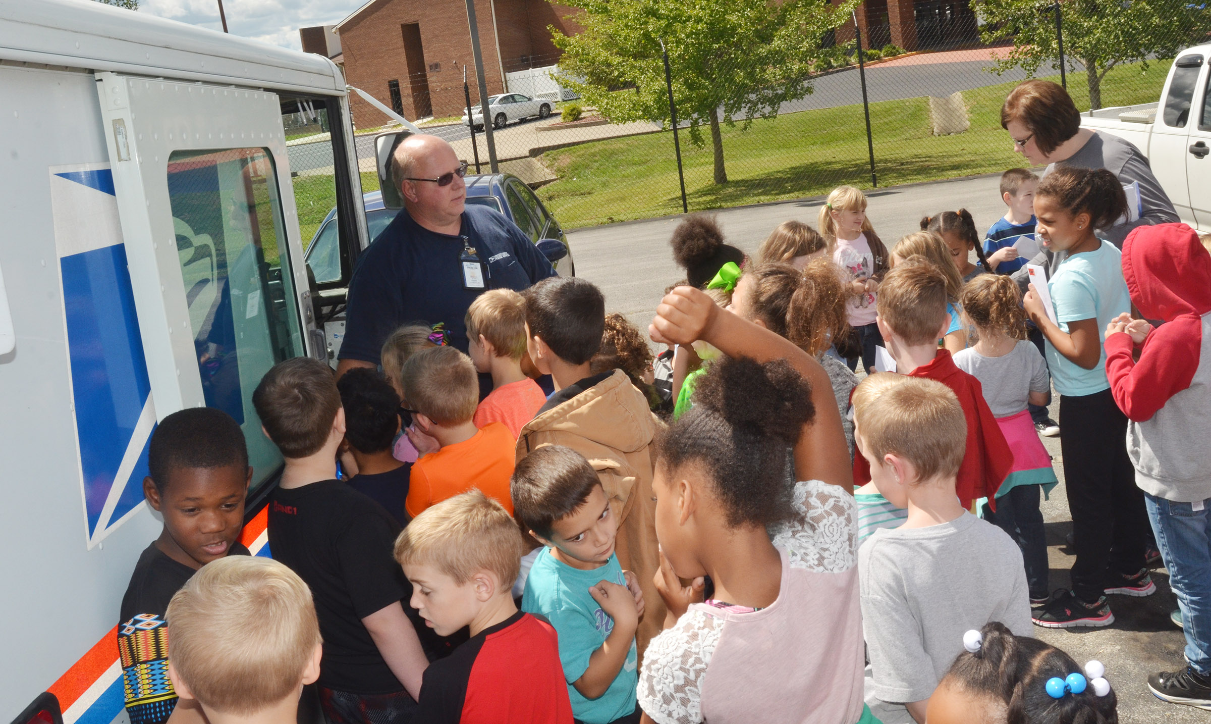 Campbellsville Post Office employee Scott Darst shows CES second-graders the inside of a mail truck.