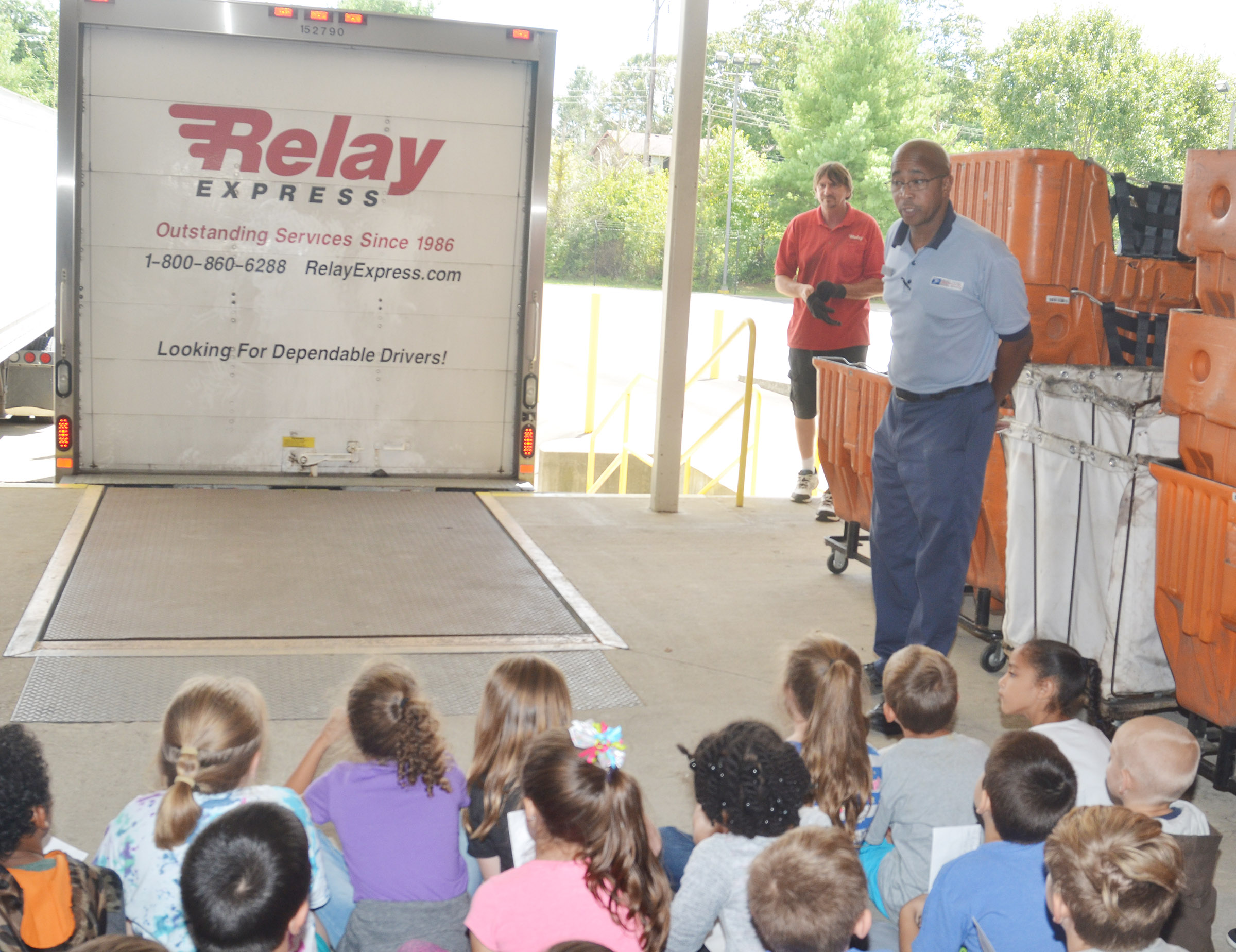 Campbellsville Post Office employee Damarco Richardson talks to CES second-graders about mail deliveries.