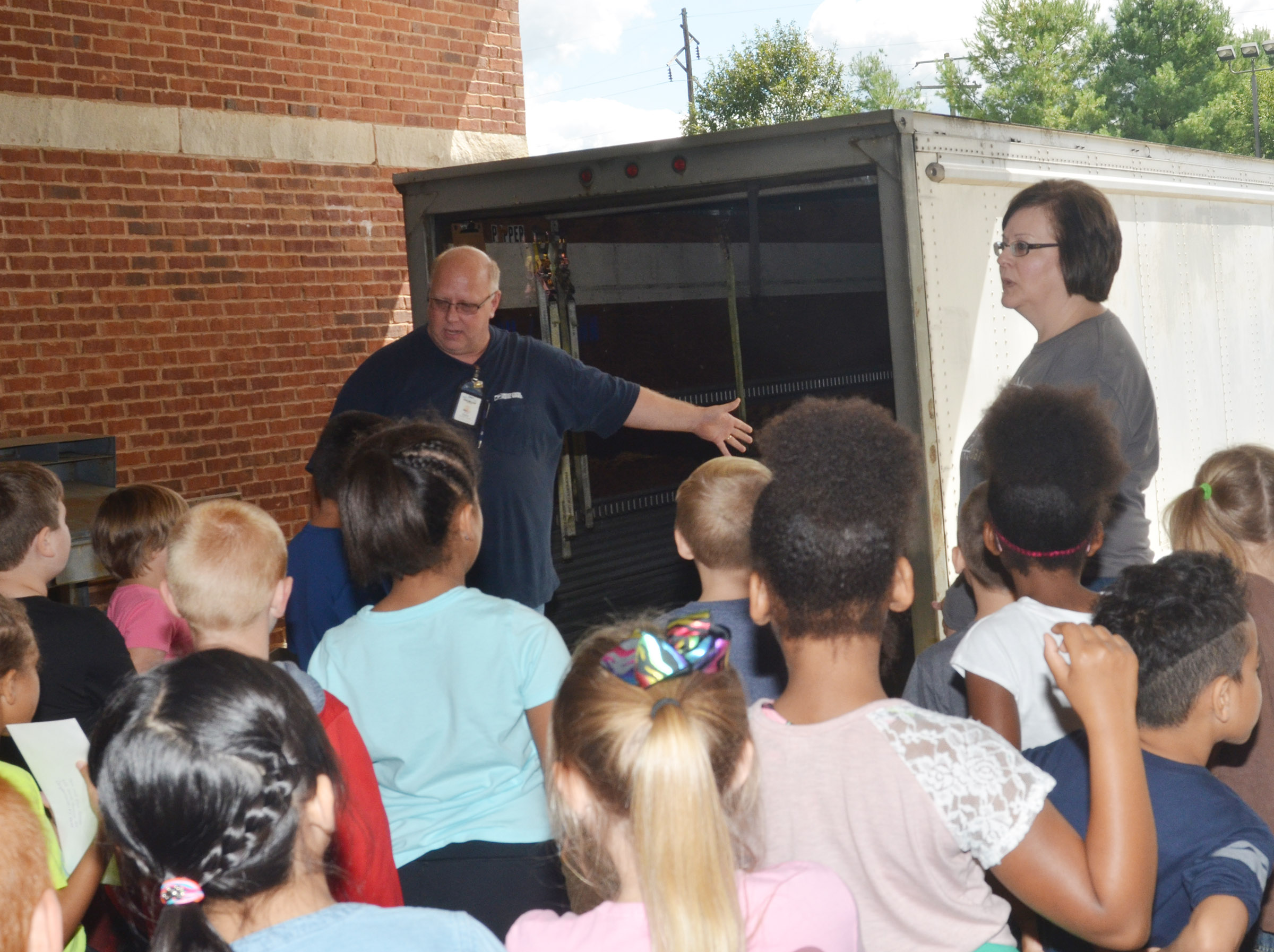 Campbellsville Post Office employee Scott Darst talks to CES second-graders about how mail is delivered to the post office in large trucks.