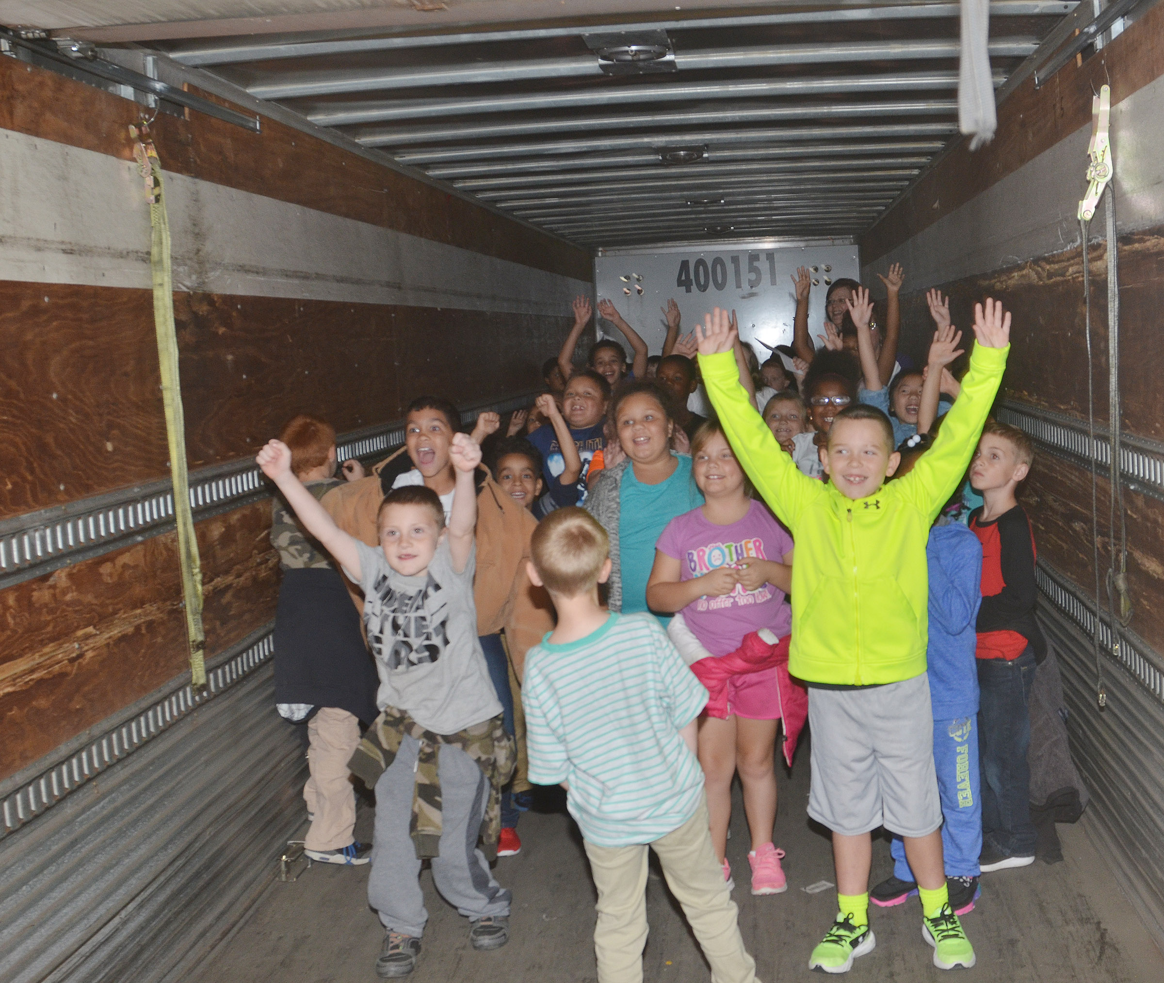CES second-graders climb inside a mail truck.