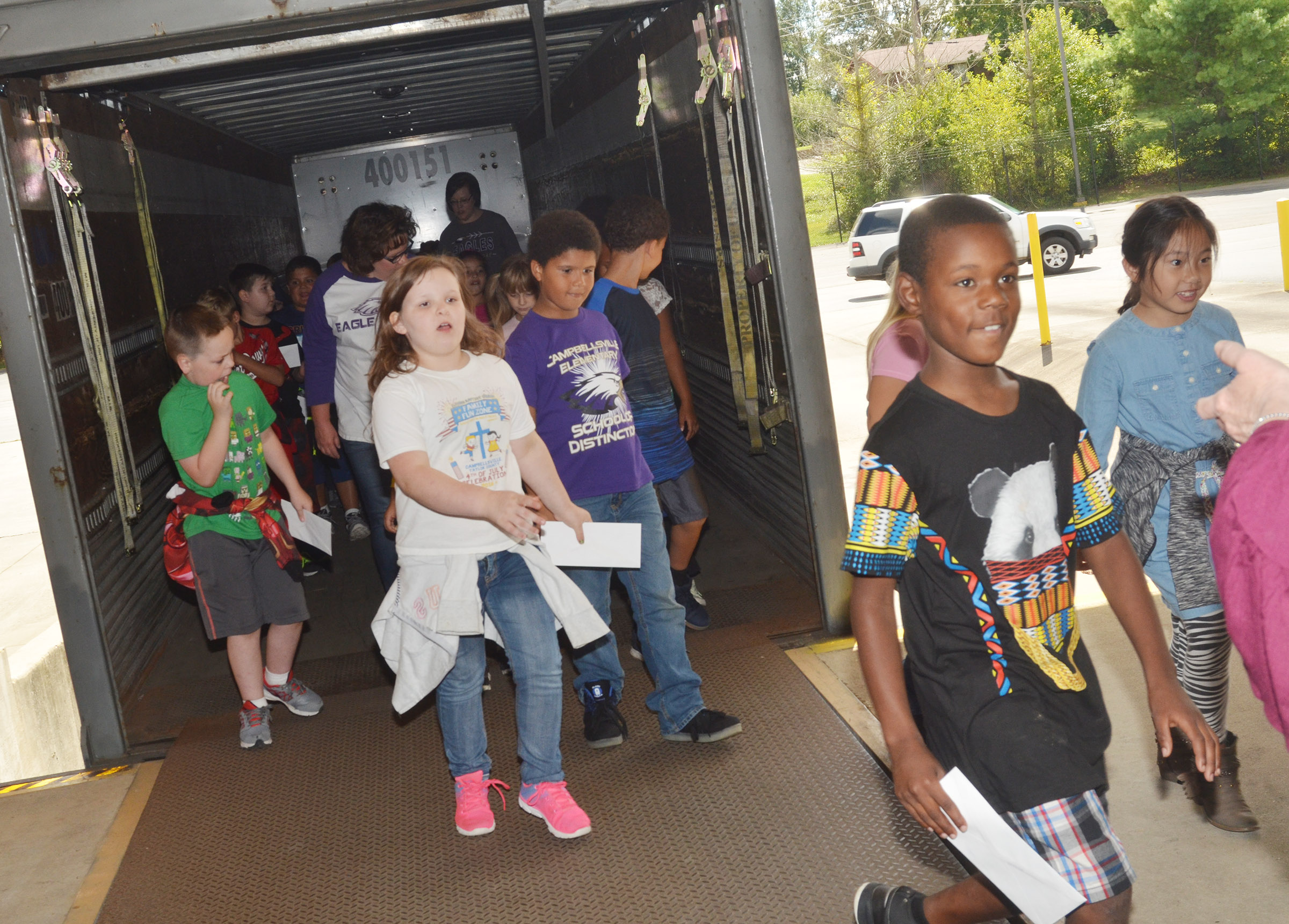 CES second-graders walk out of the mail truck.