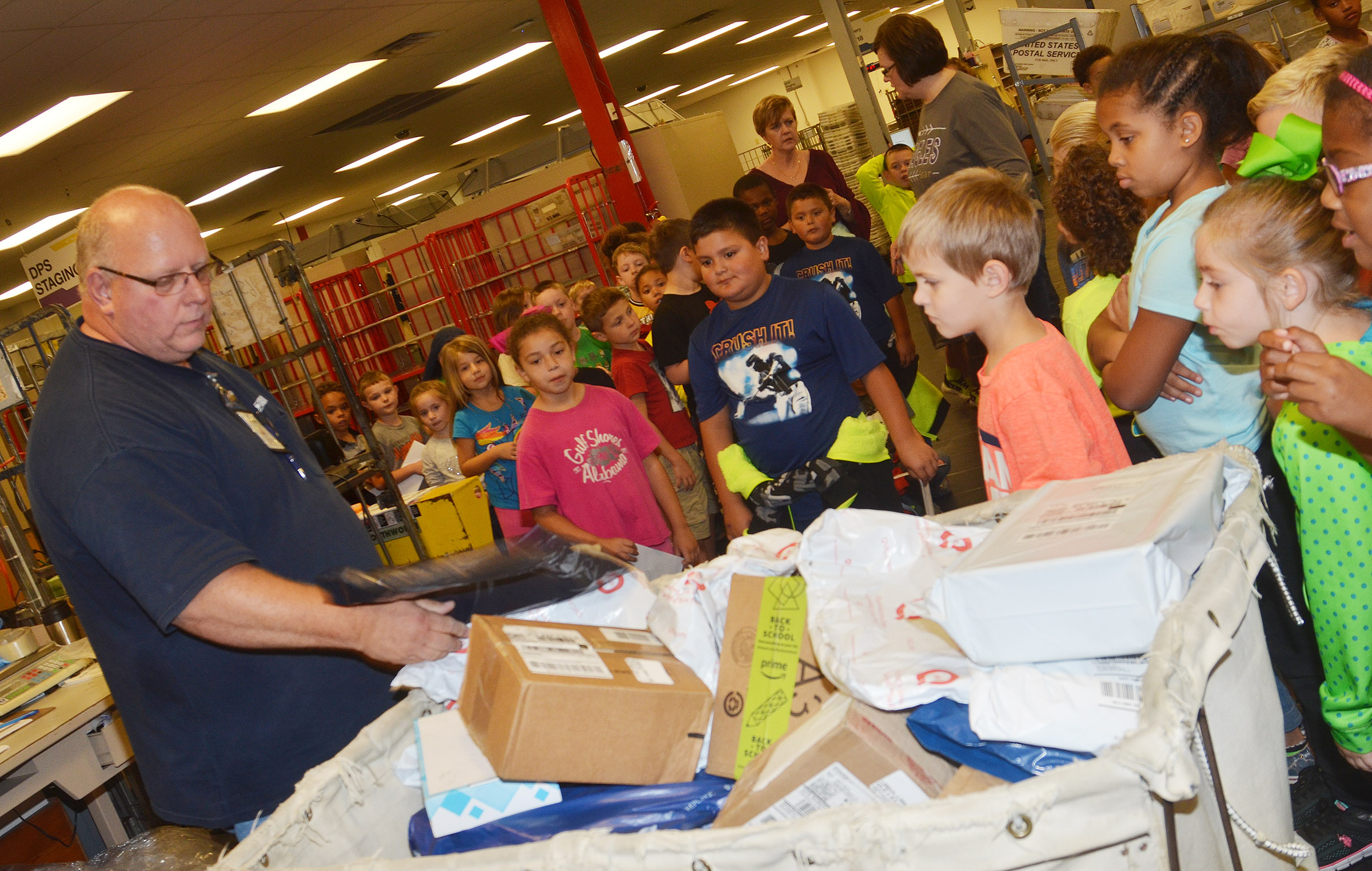 Campbellsville Post Office employee Scott Darst shows CES second-graders how mail is sorted.