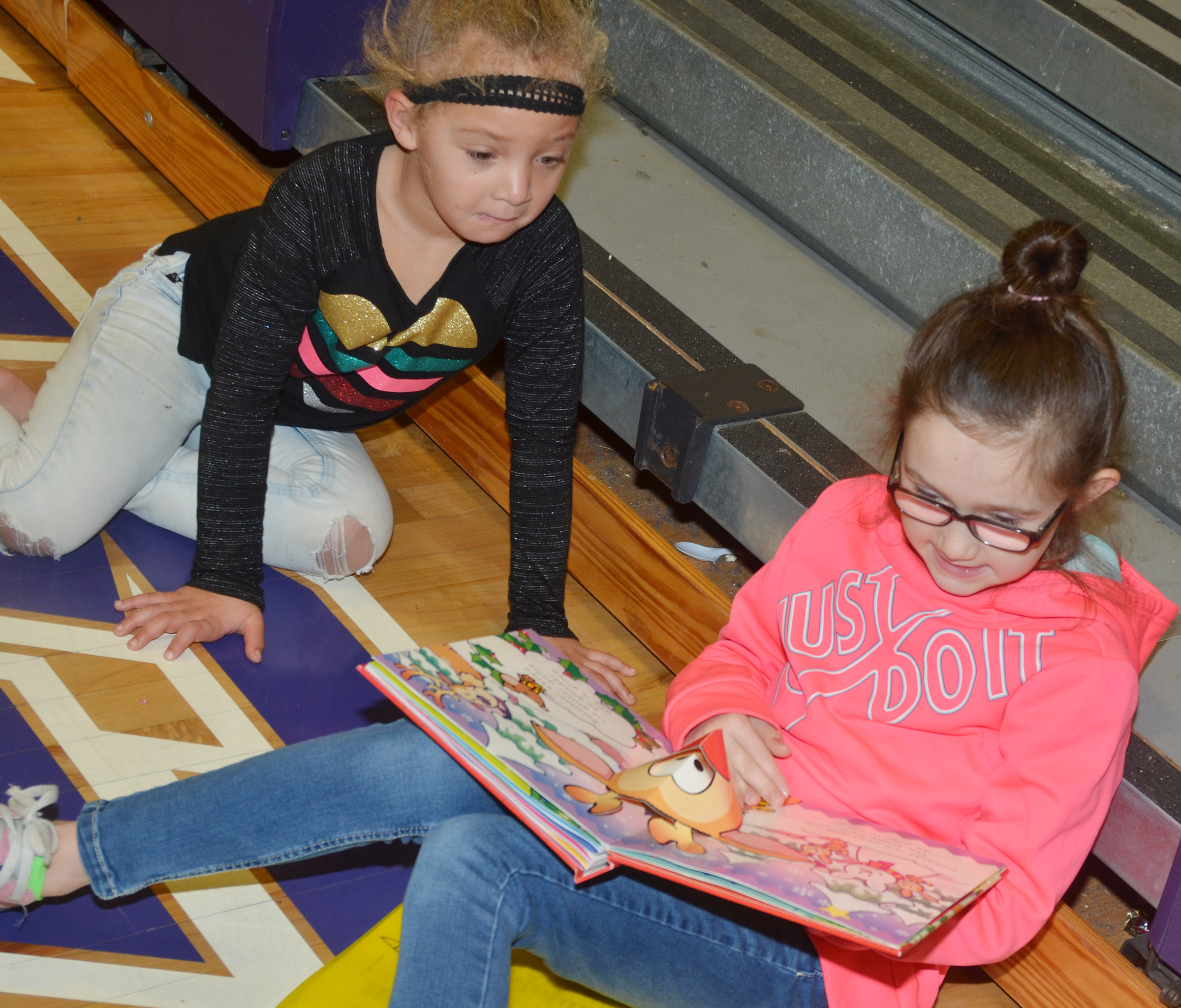 CES second-grader Anna Keith reads to preschool student Jayla Barbee.