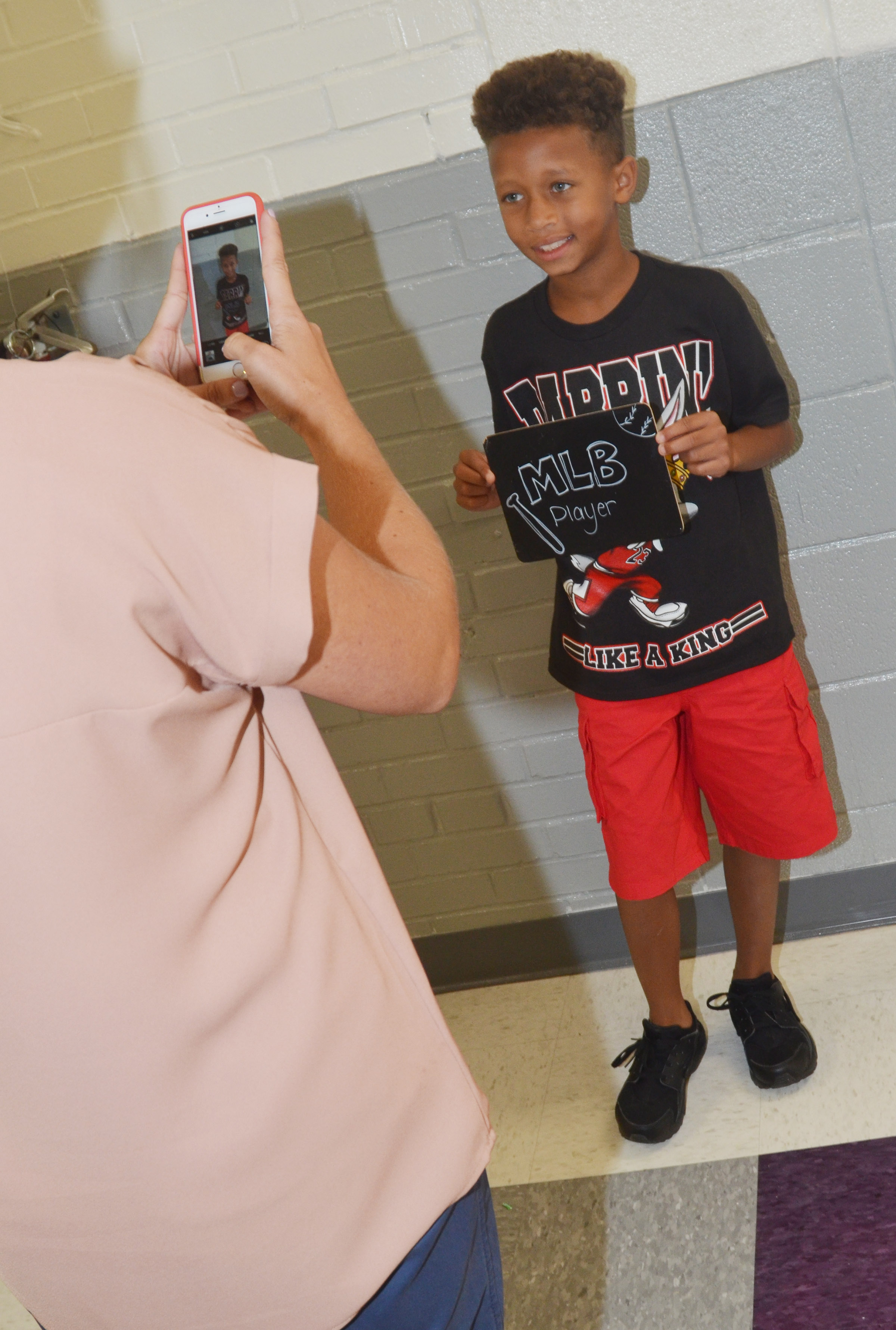 CES third-grader Rajon Taylor, who wants to be a professional baseball player when he gets older, smiles for a photo.