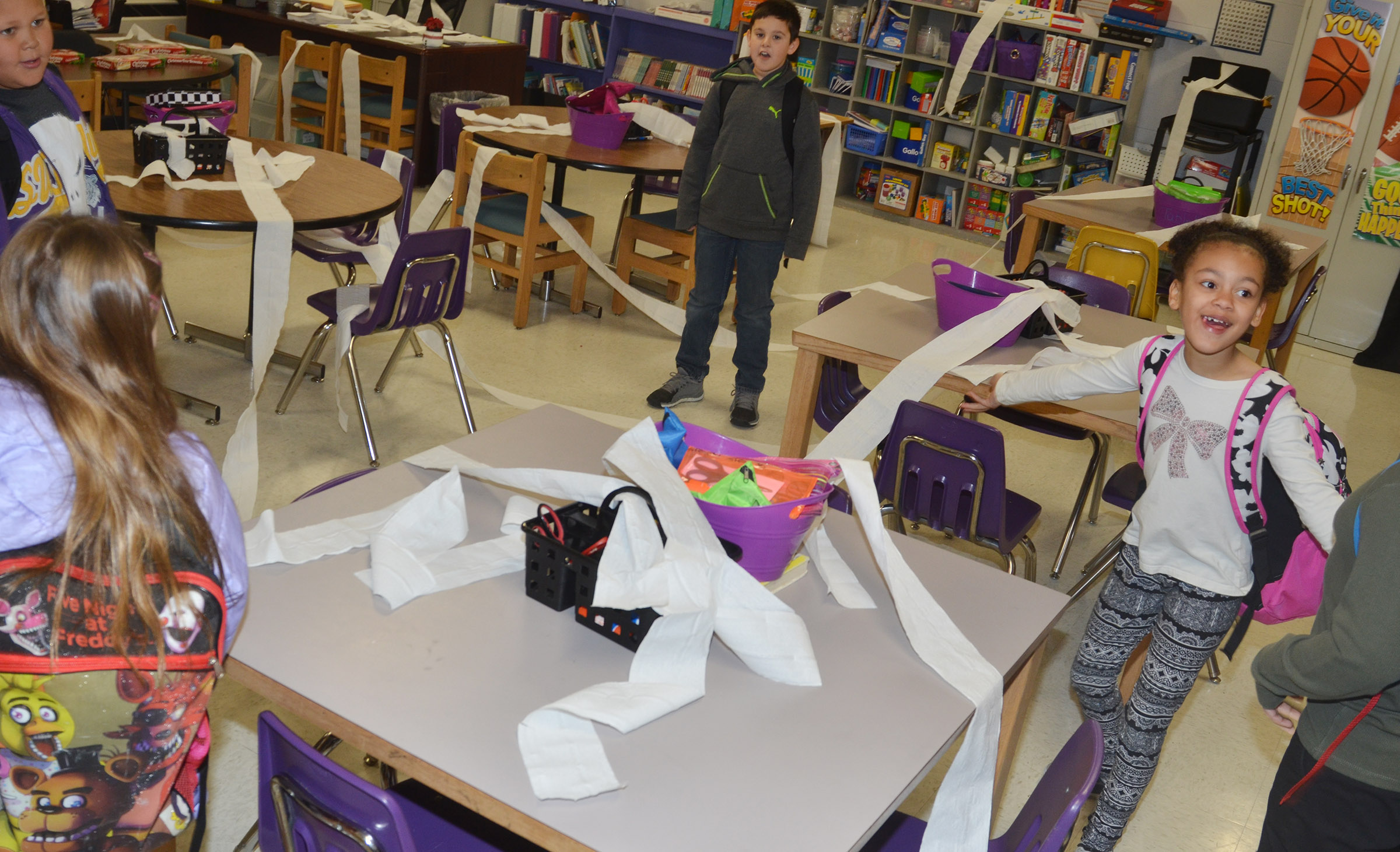 CES third-graders in Patty Haley's class came to school recently and found their elf had thrown toilet paper all over their classroom.