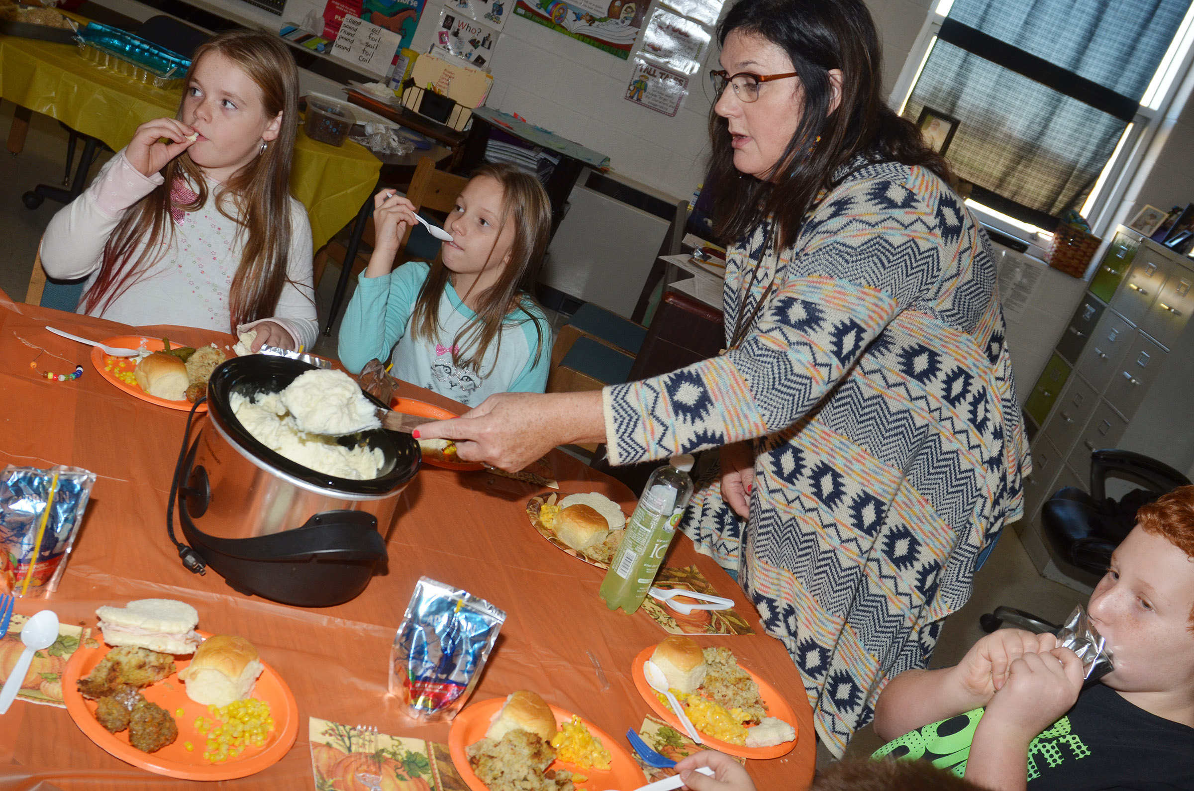 CES third-grade teacher Patty Haley serves her students.