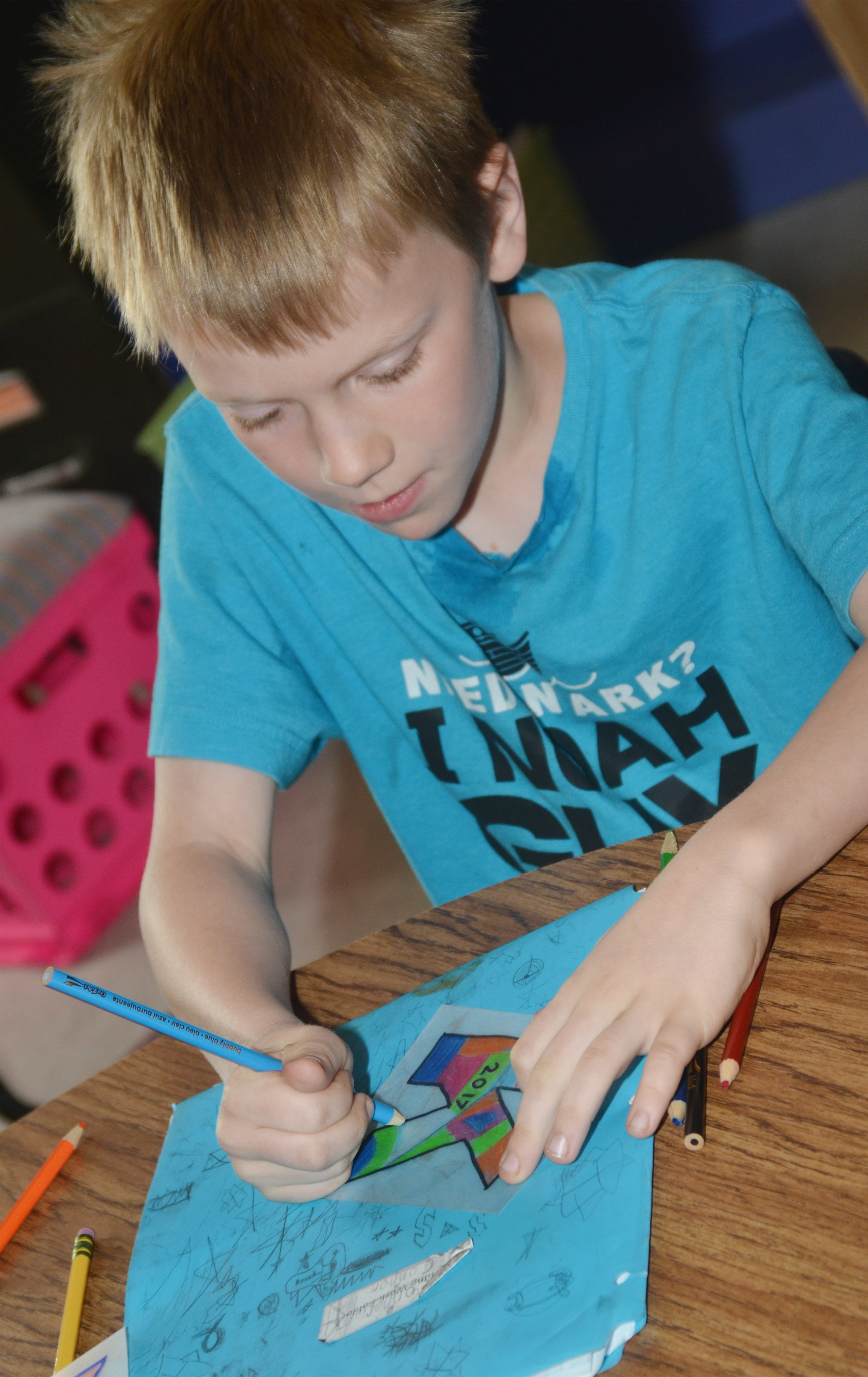 CES third-grader Connor Coots decorates what will become a keychain for his mother.
