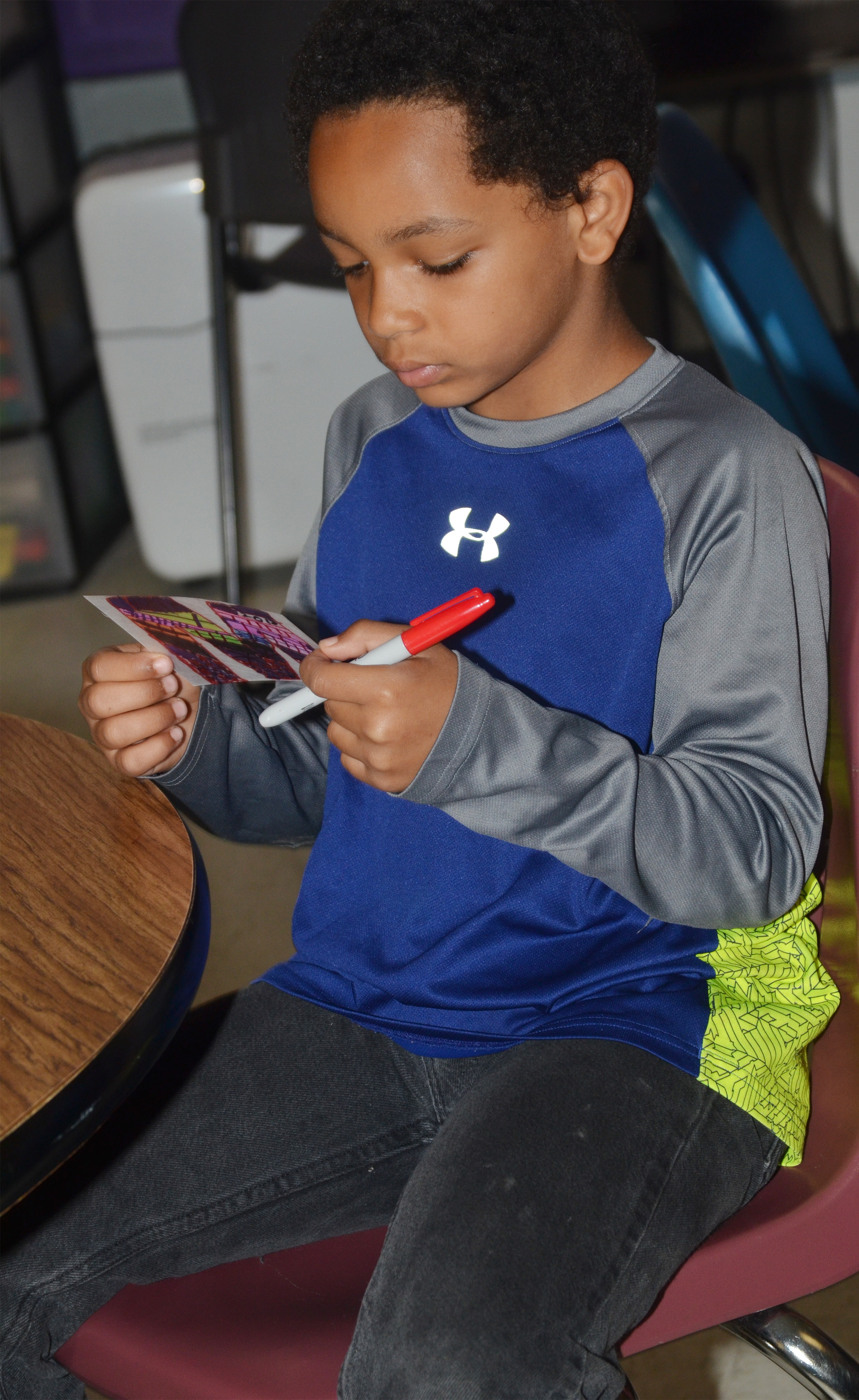 CES third-grader Jalen Embry decorates what will become a keychain for his mother.